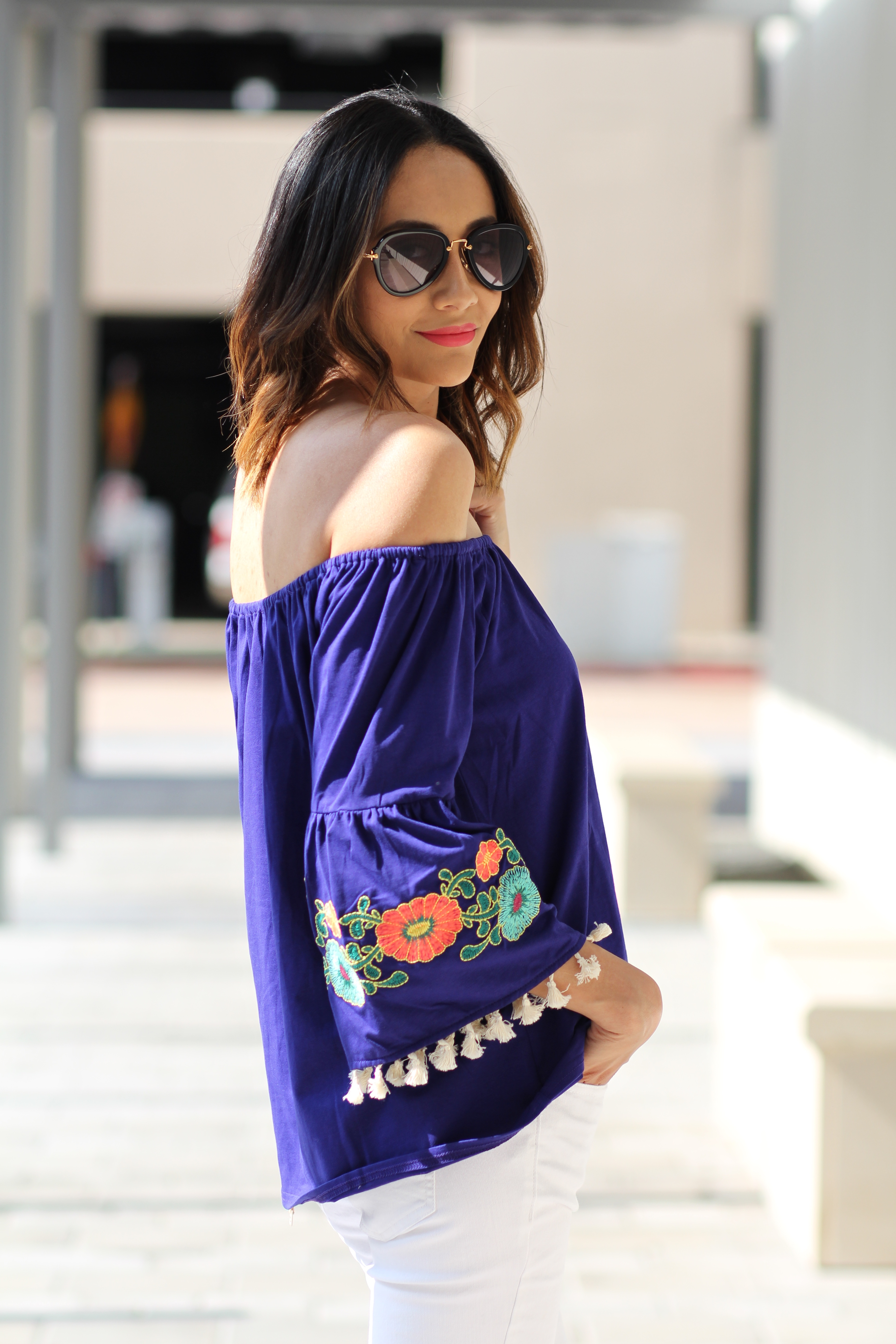 off the shoulder top with embroidered bell sleeves