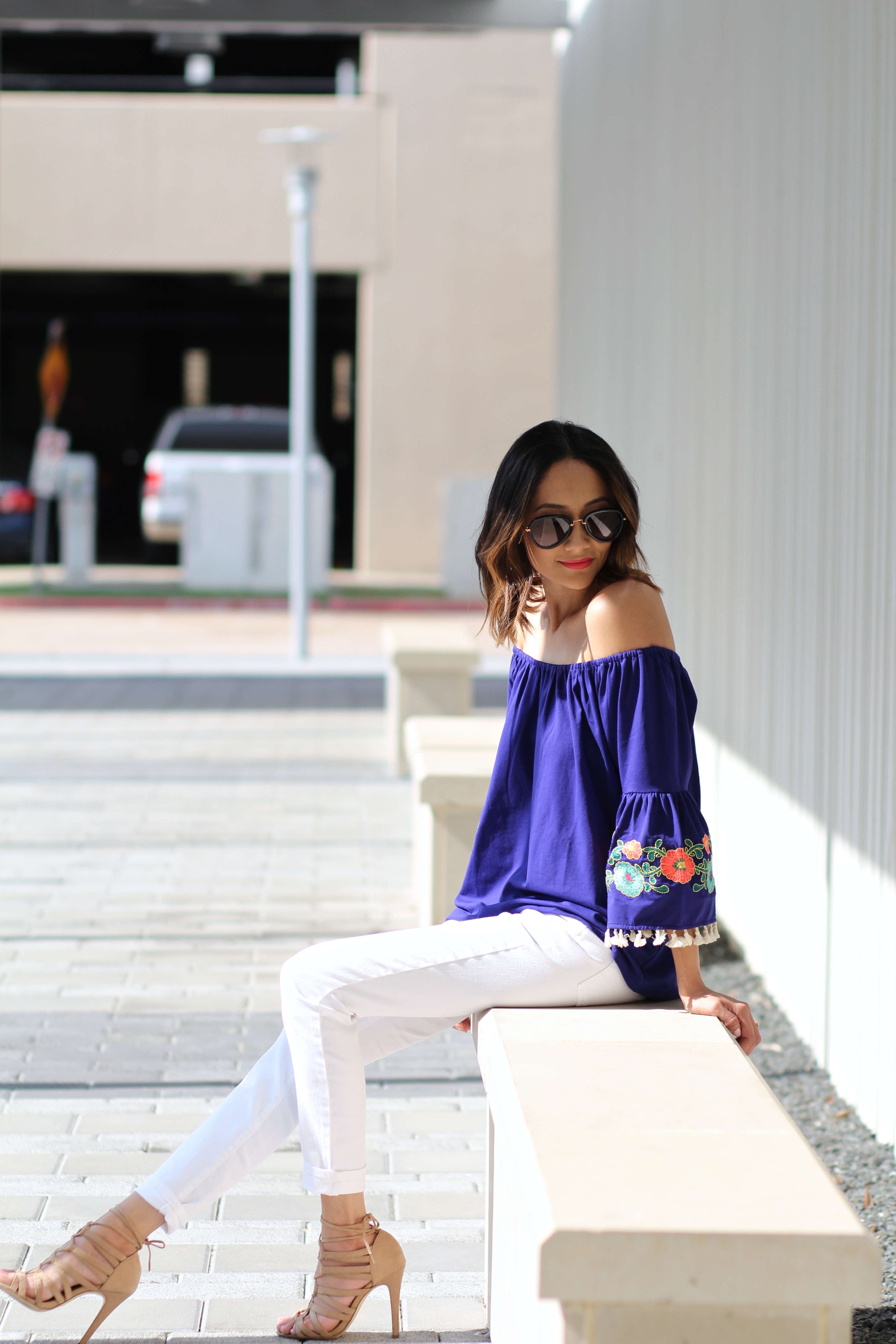 embroidered bell sleeves off the shoulder top and white skinny jeans