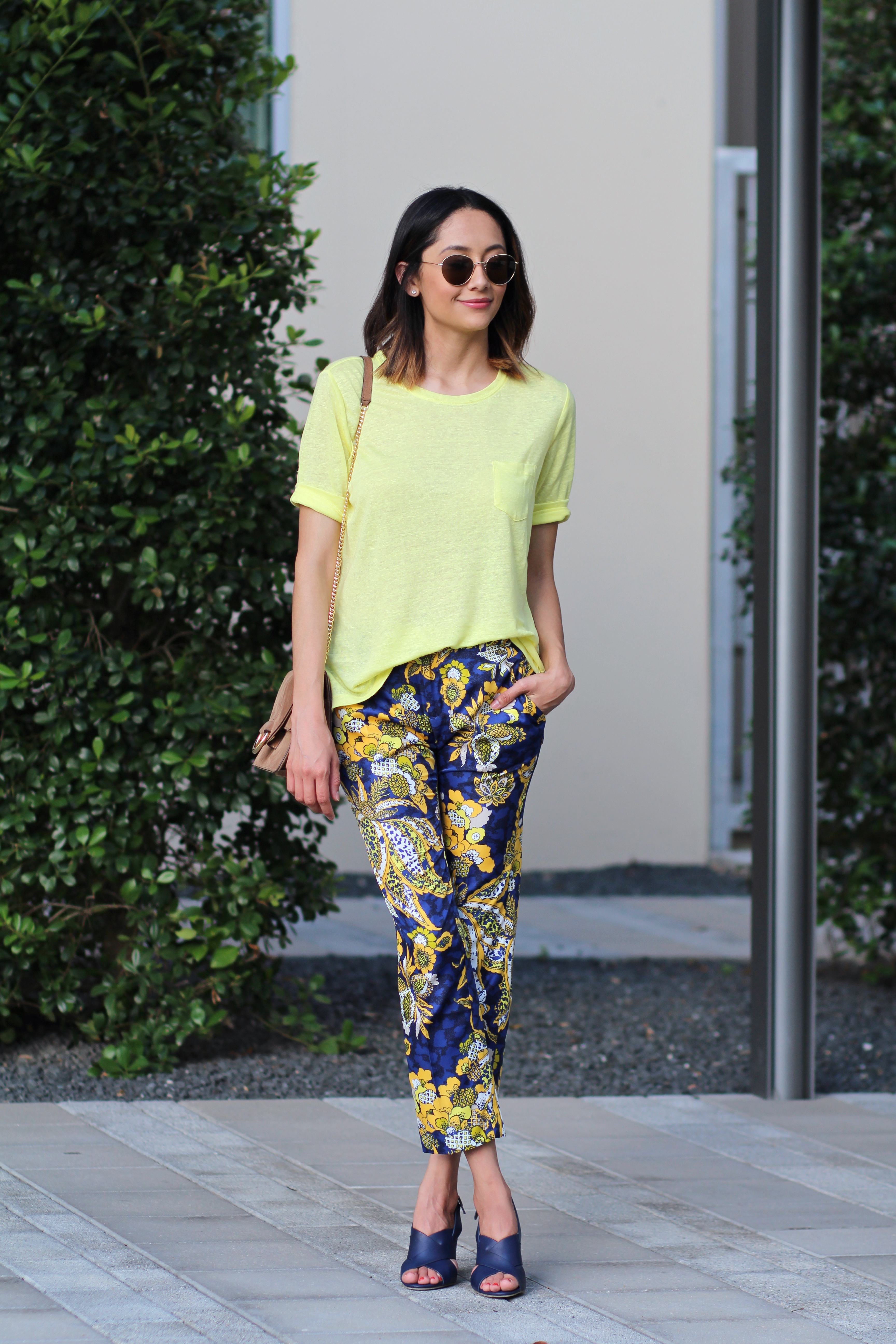 Fashion blogger Lilly Beltran of Daily Craving wearing yellow and blue floral printed pants