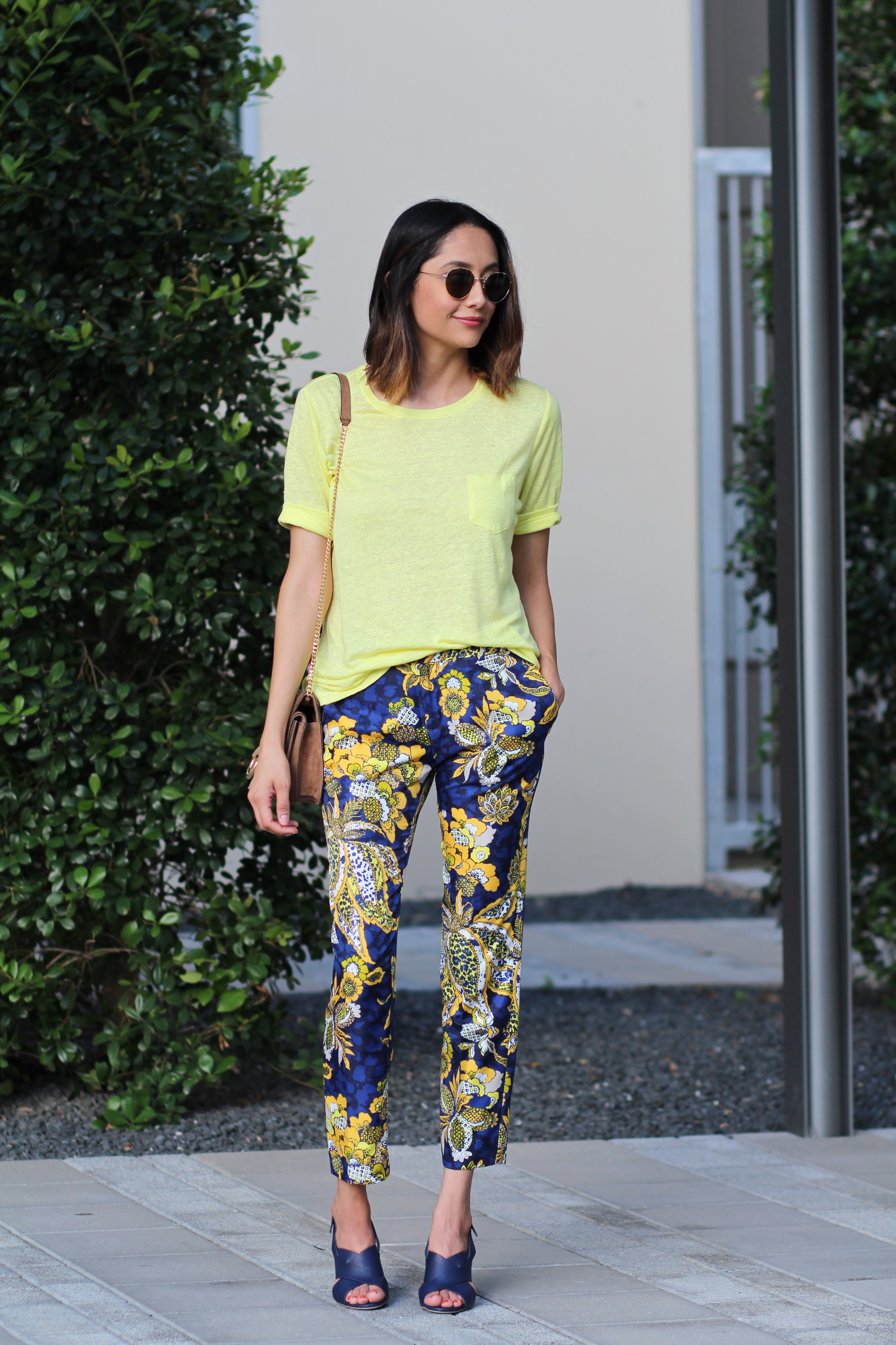 Fashion blogger Lilly Beltran of Daily Craving in floral printed Banana Republic pants and navy block heel sandals