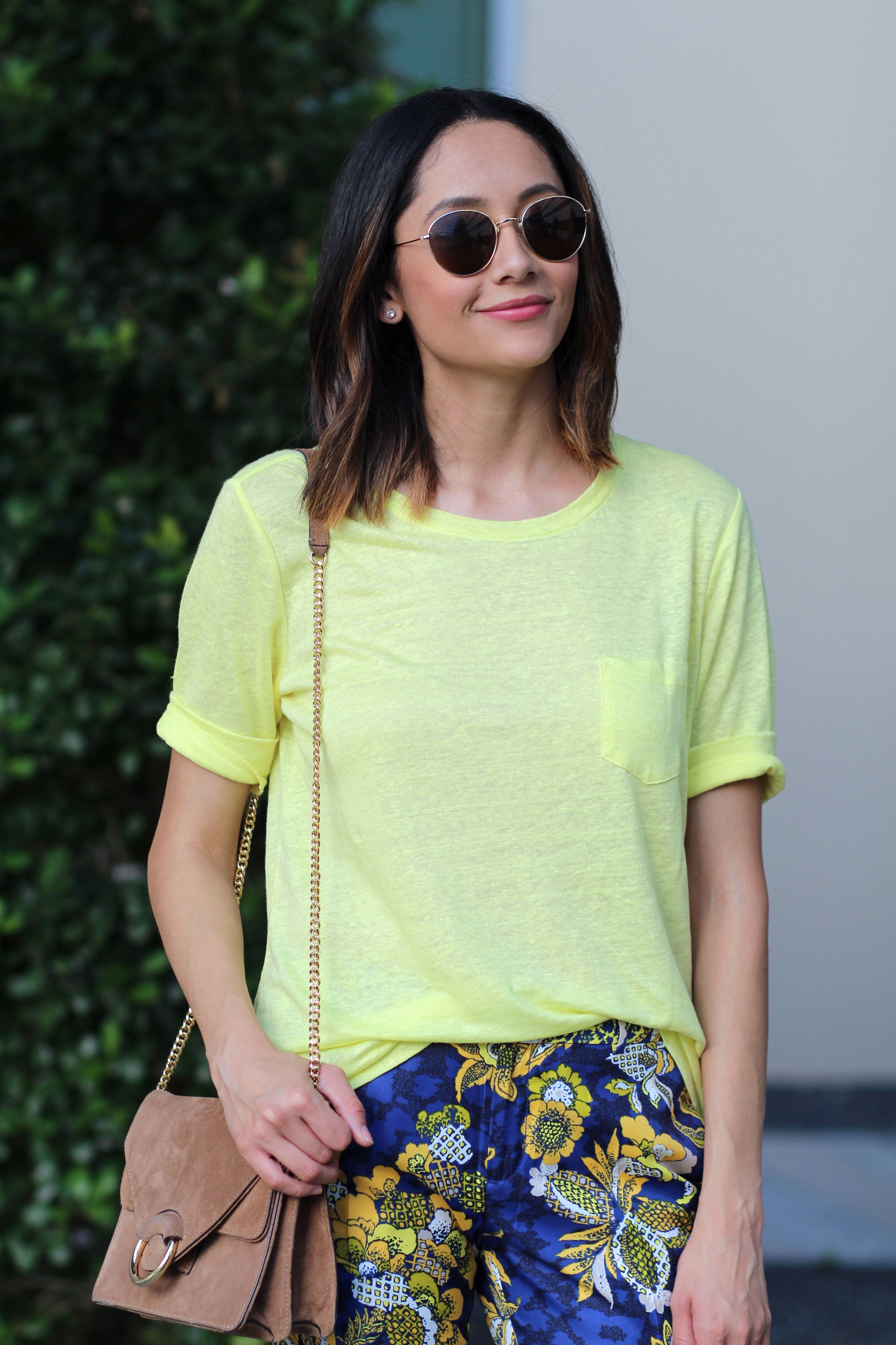 Fashion blogger Lilly Beltran of Daily Craving stylsh look wearing a yellow tee and floral print Banana Republic pants