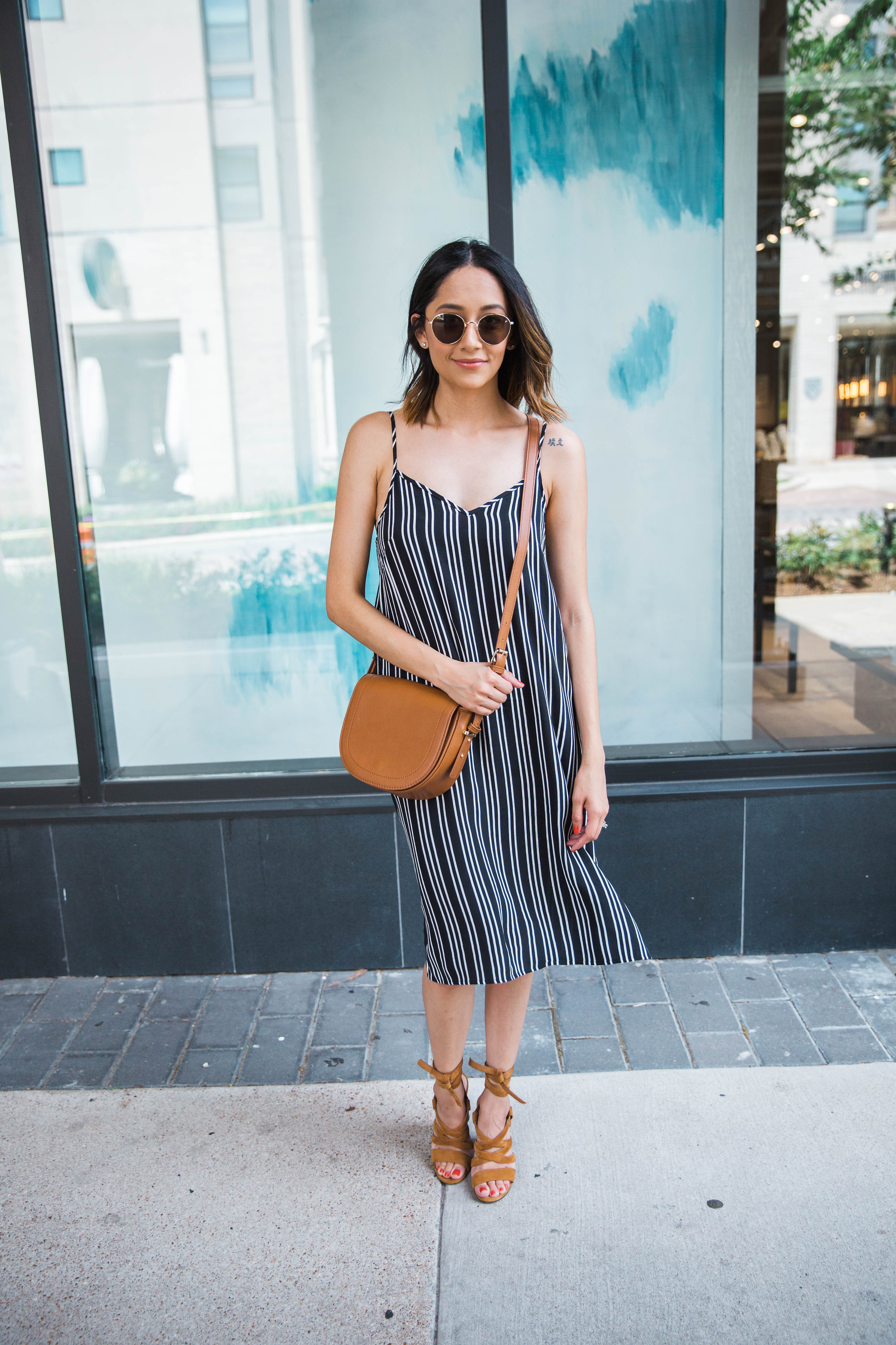 Lilly Beltran of Daily Craving wearing a striped slip dress with suede lace-up sandals