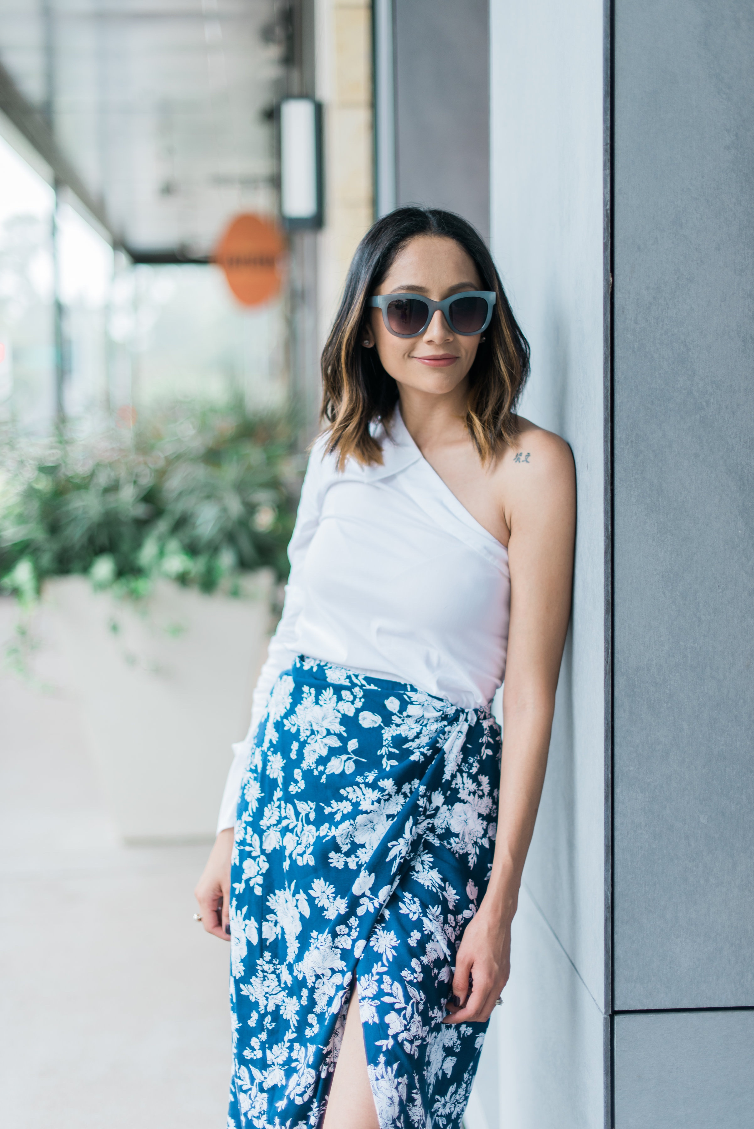 Lifestyle blogger Lilly Beltran from Daily Craving in a summer look wearing a floral wrap skirt and one shoulder top