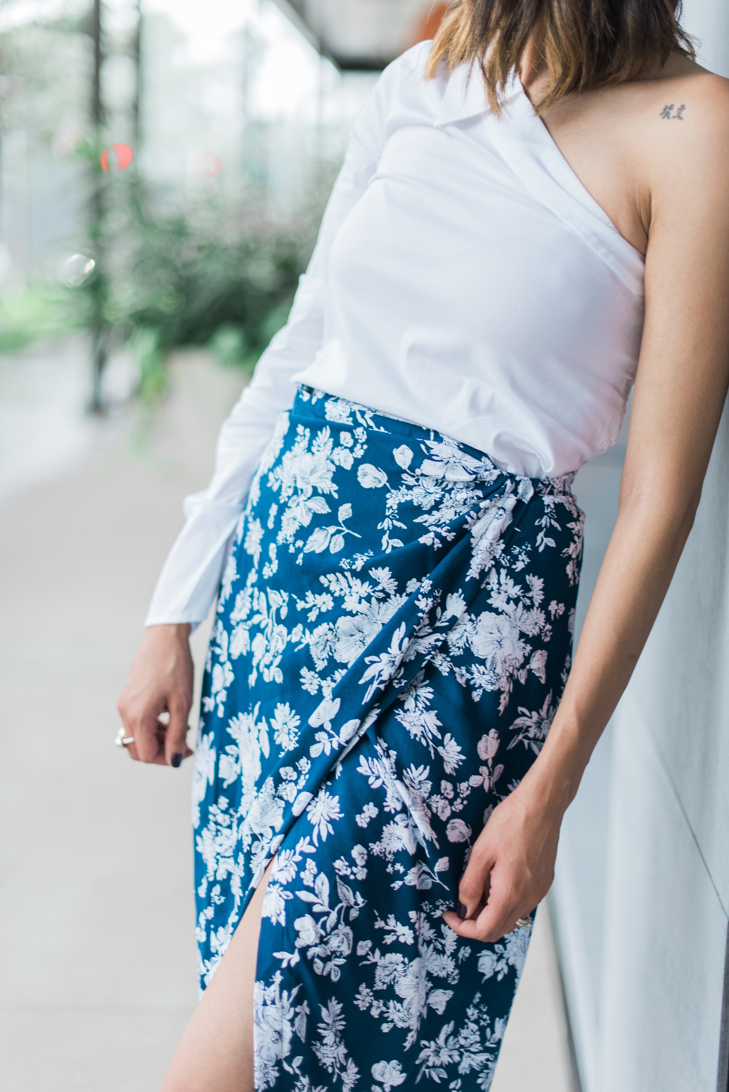 Lilly Beltran of Daily Craving Blog wearing a blue wrap skirt and one sleeve shirt