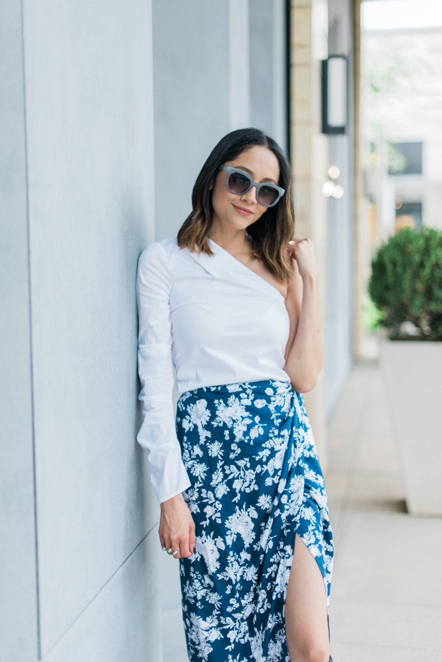 Lifestyle blogger Lilly Beltran of Daily Craving wearing a floral print wrap skirt and one sleeve top
