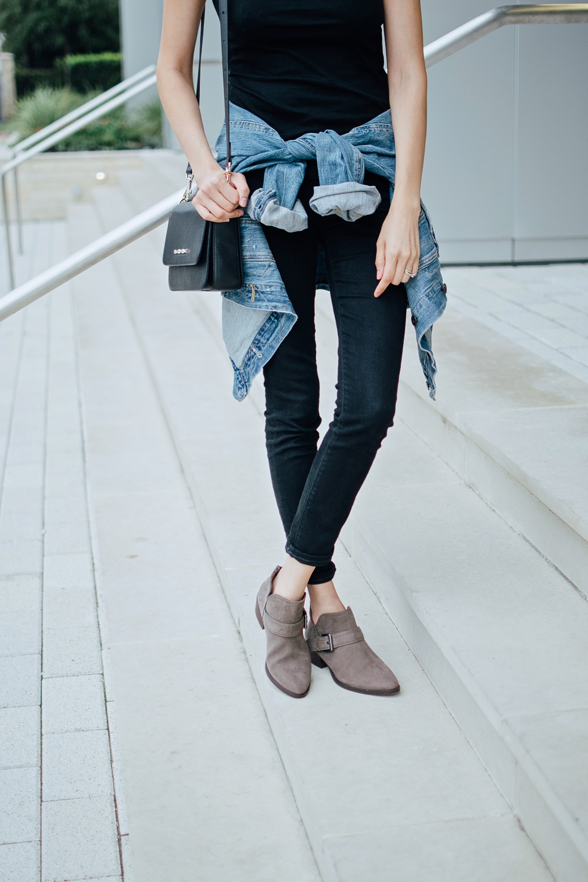 Daily Craving wearing a pair of versatile boots with black skinny jeans and a basic black tee