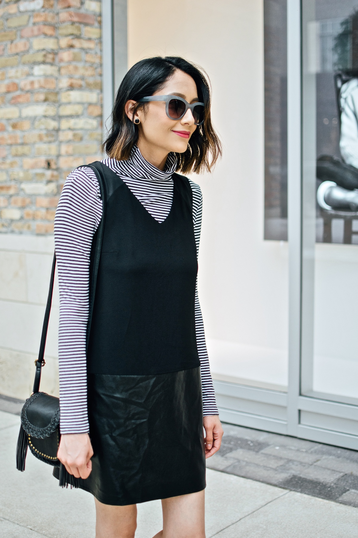 Daily Craving wearing a chic fall outfit with a black dress and striped t-shirt