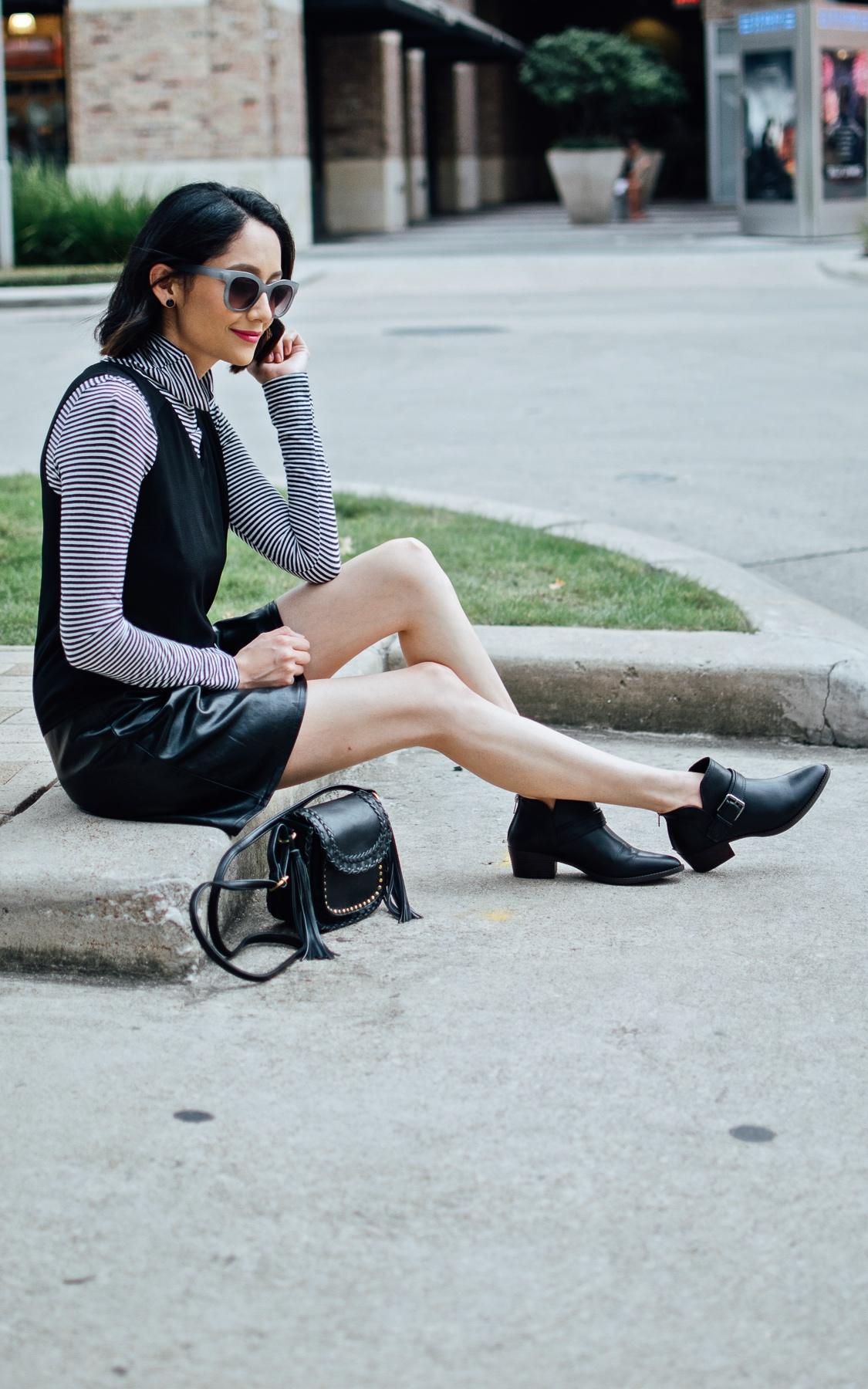 Style blogger Lilly Beltran of Daily Craving blog wearing a black dress over a striped turtleneck top