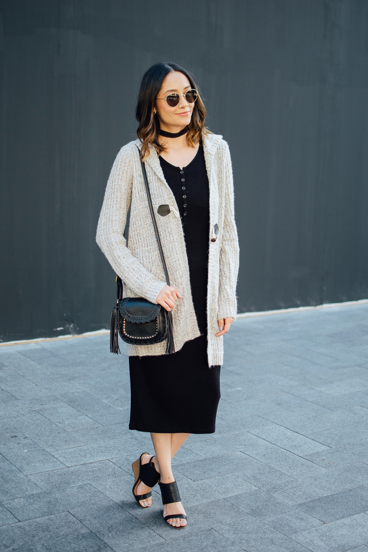 Style blogger Lilly Beltran of Daily Craving in a Fall look with a black knit dress, midi cardigan and velvet choker