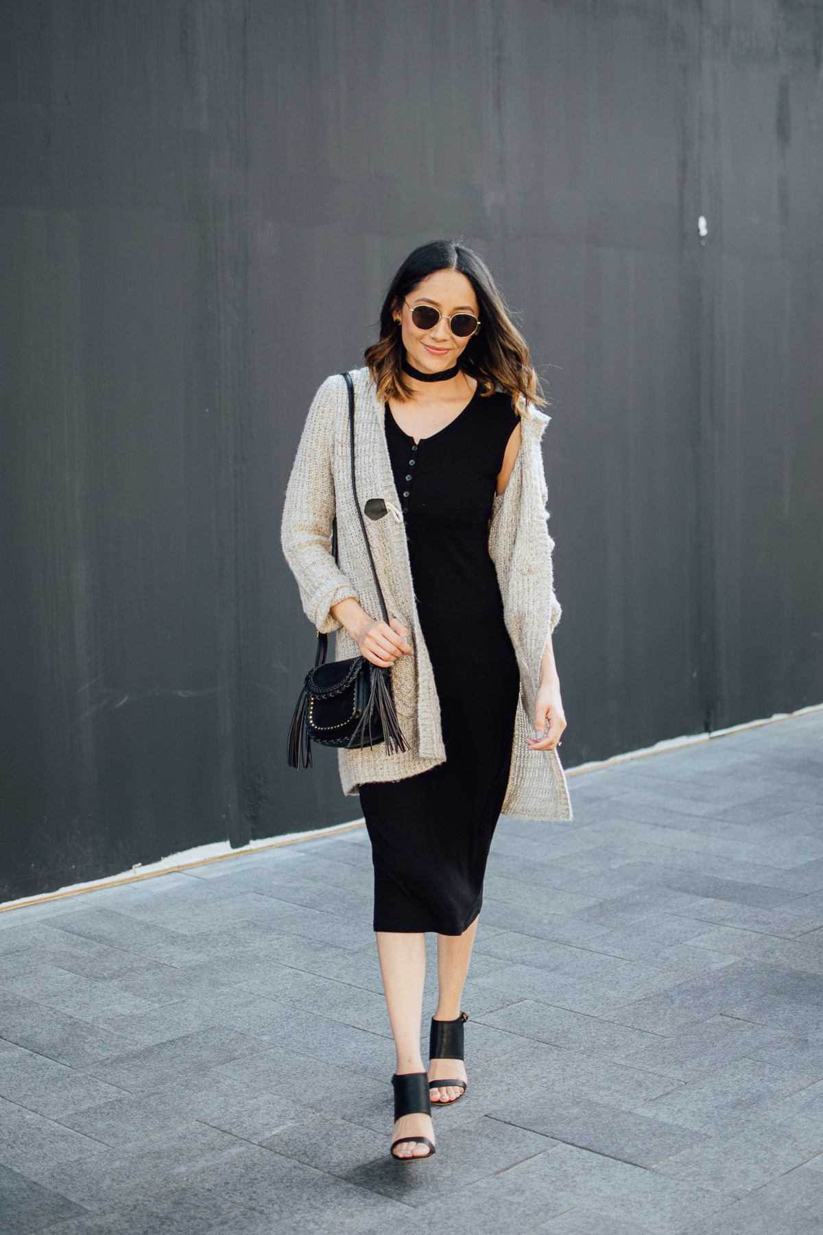 Lilly Beltran of Daily Craving in chic fall look with a black midi dress and beige cardigan