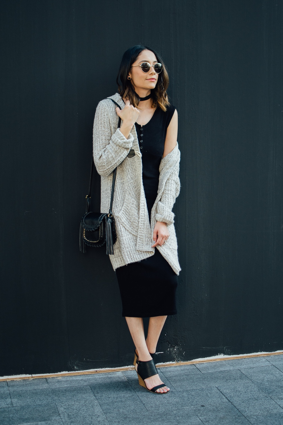 Style blogger Lilly Beltran of Daily Craving in a casual fall look with a long cardigan and black midi dress