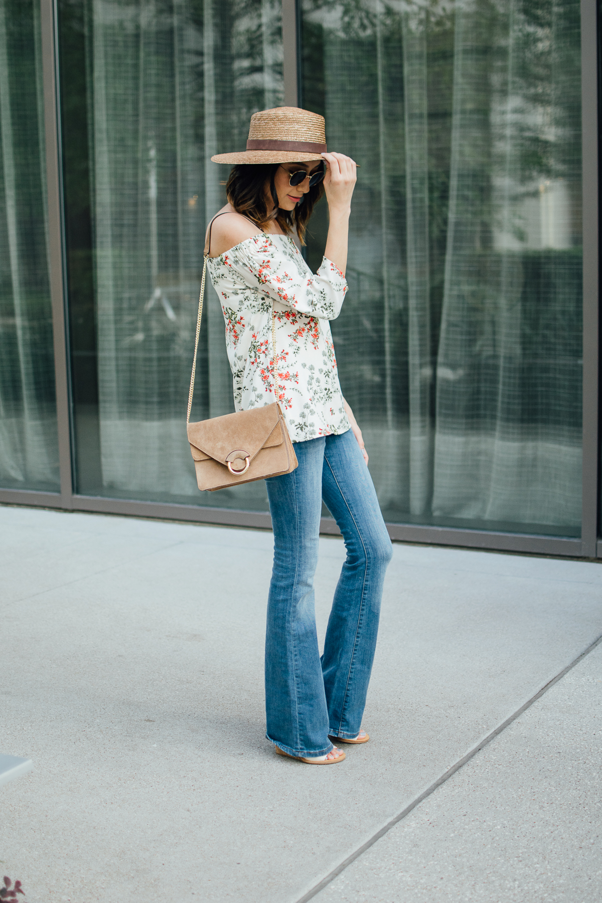 Off-the-shoulder top & flare jeans