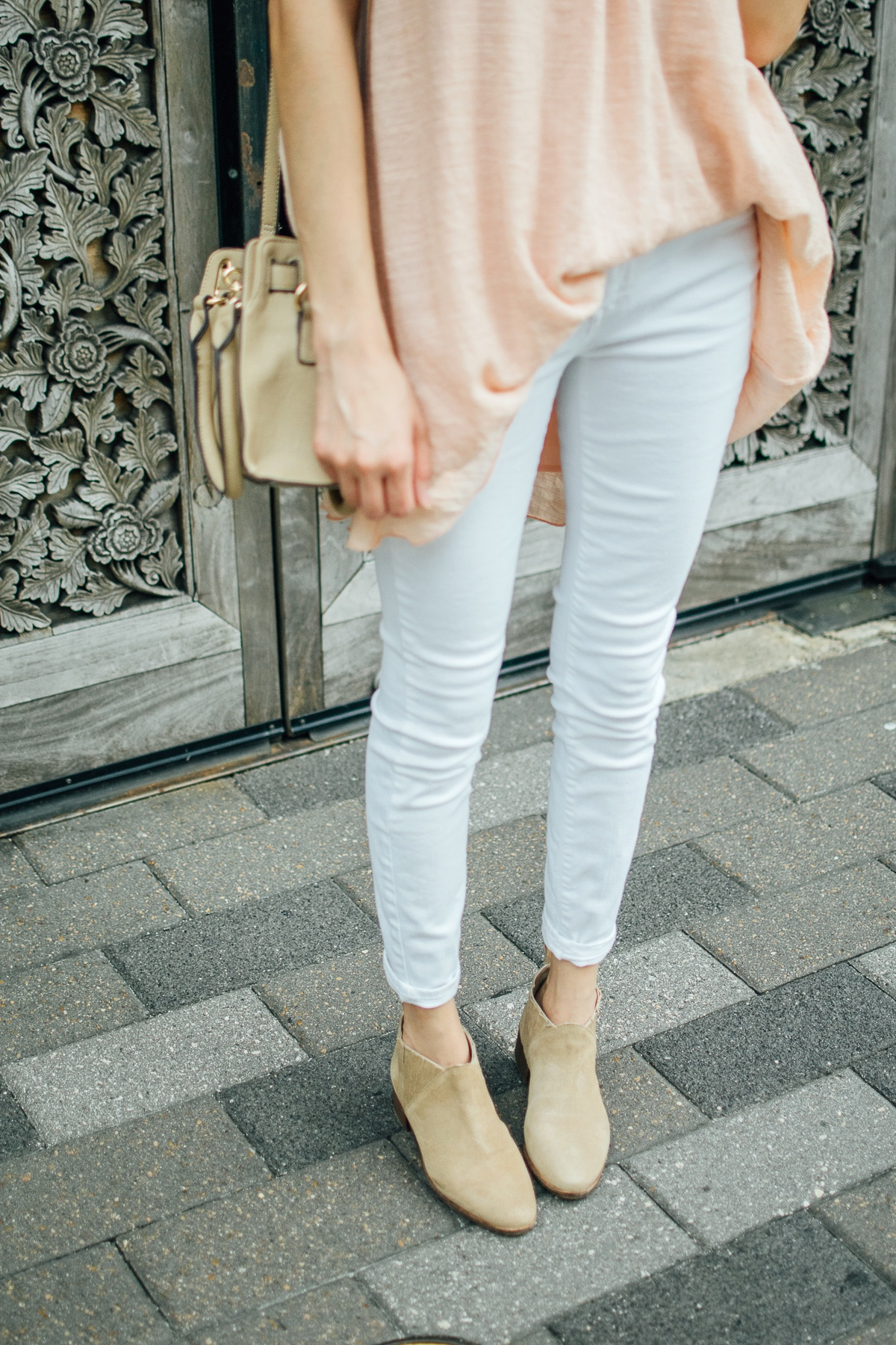 White skinny jeans and nude suede ankle boots