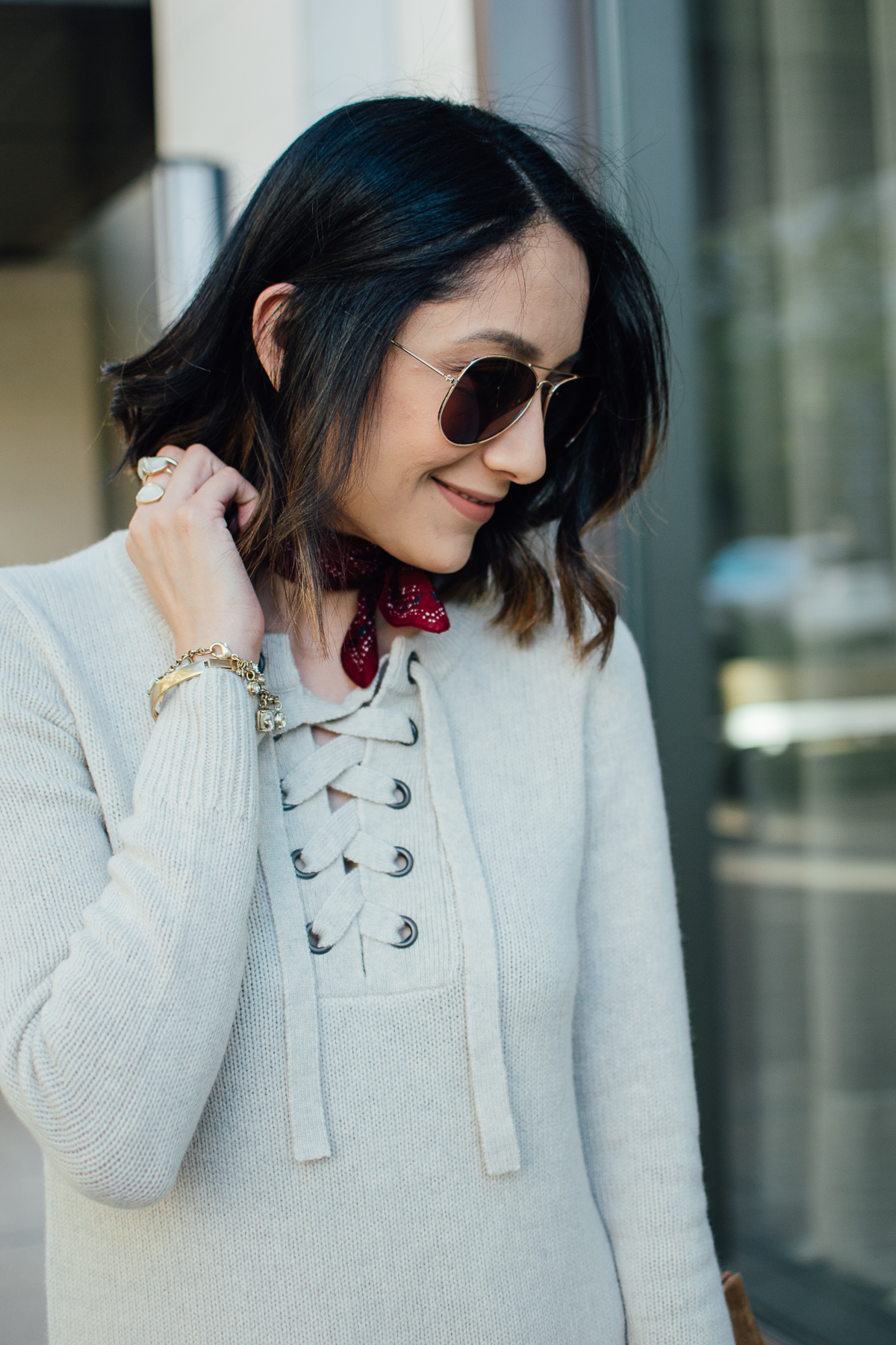 Houston based style blog Daily Craving | Brunette woman wearing lace up sweater dress | Brunette messy waves