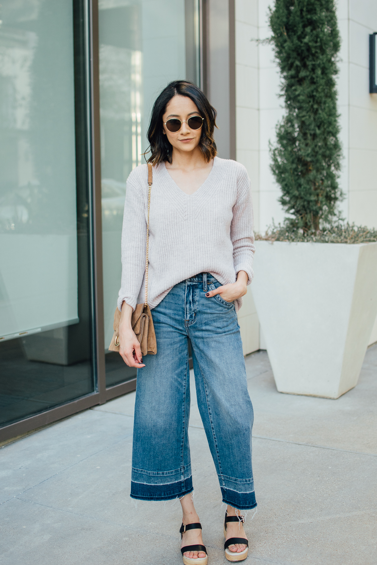 Daily craving wears a casual fall outfit with wide leg denim and v-neck sweater