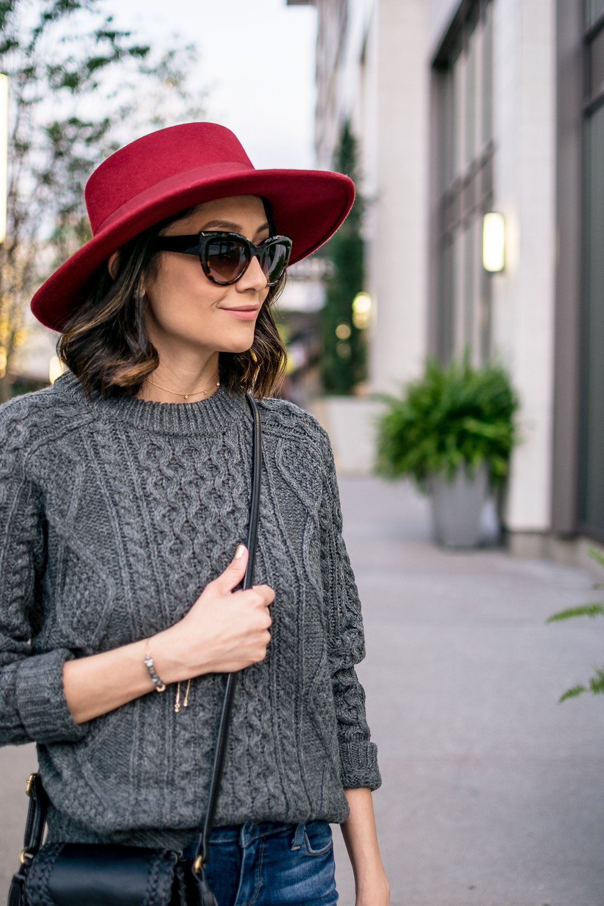 Style blogger Lilly Beltran of Daily Craving wearing a red boater hat