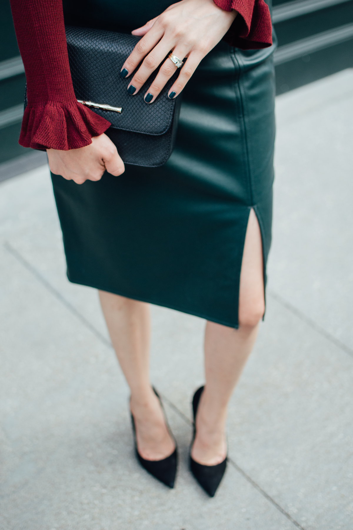 Green vegan leather skirt with slit and bell sleeve sweater