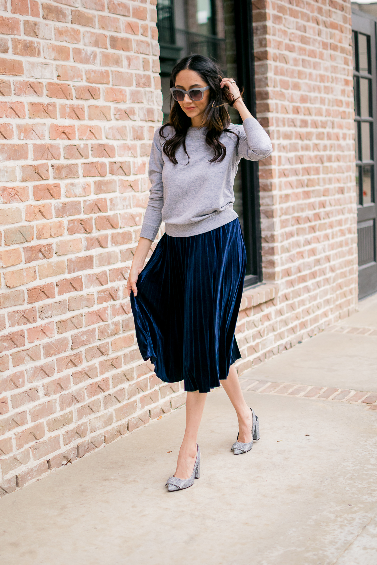 Daily craving wearing a blue pleated velvet skirt with silver glitter pumps