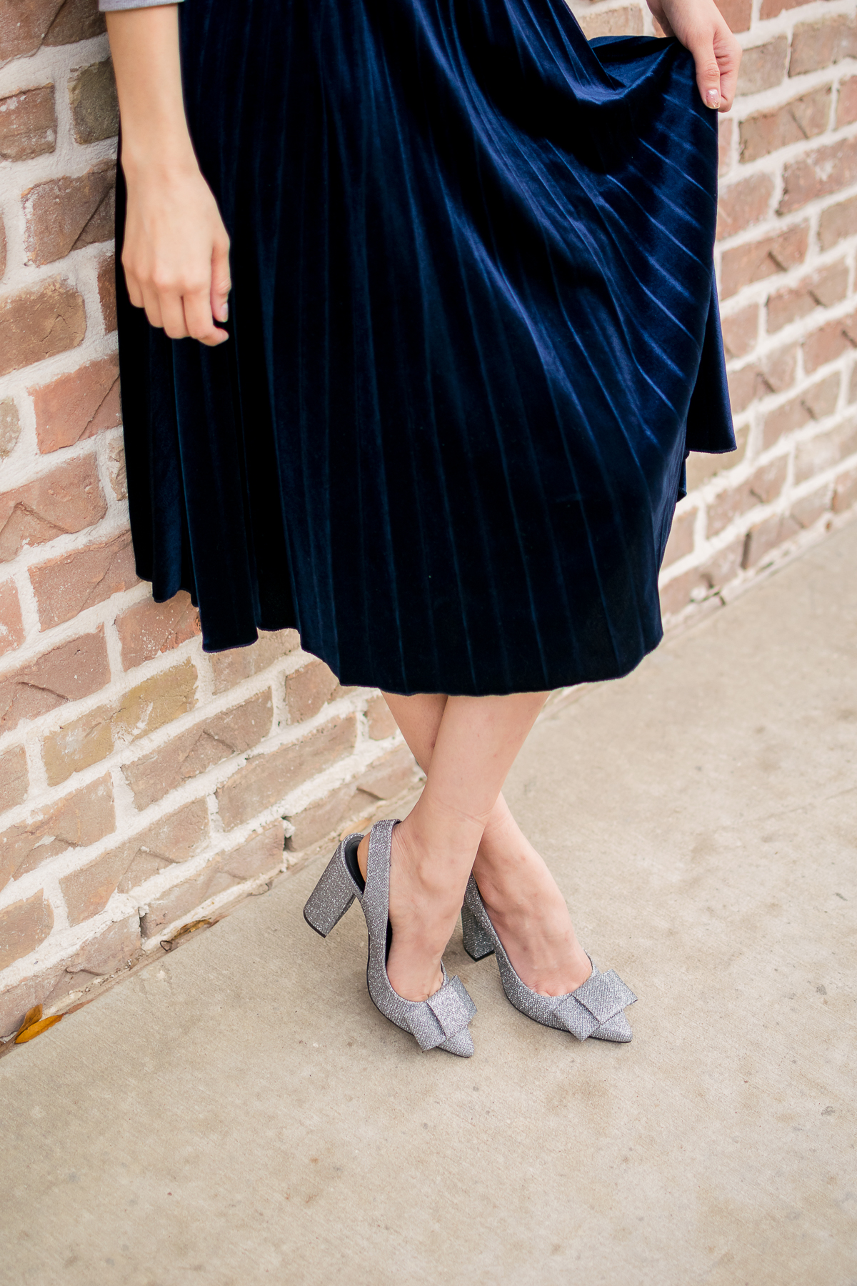 pleated velvet skirt and glitter shoes