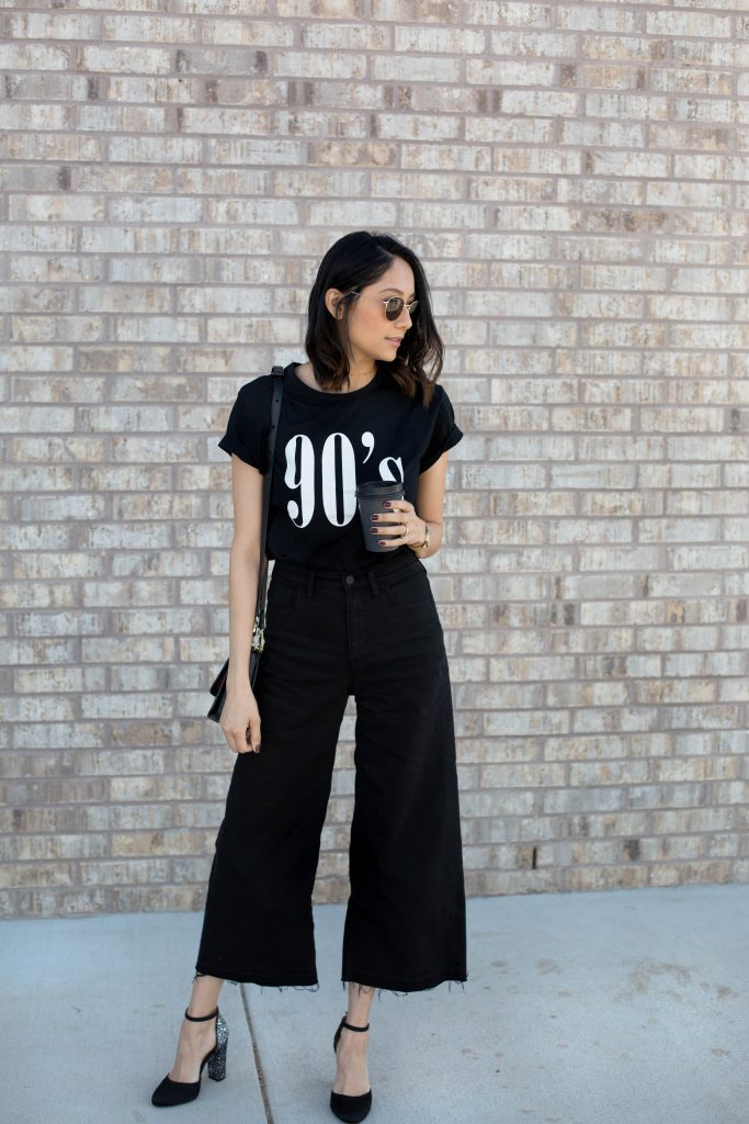 Lilly Beltran wearing black denim pants with a graphic tee for a casual look
