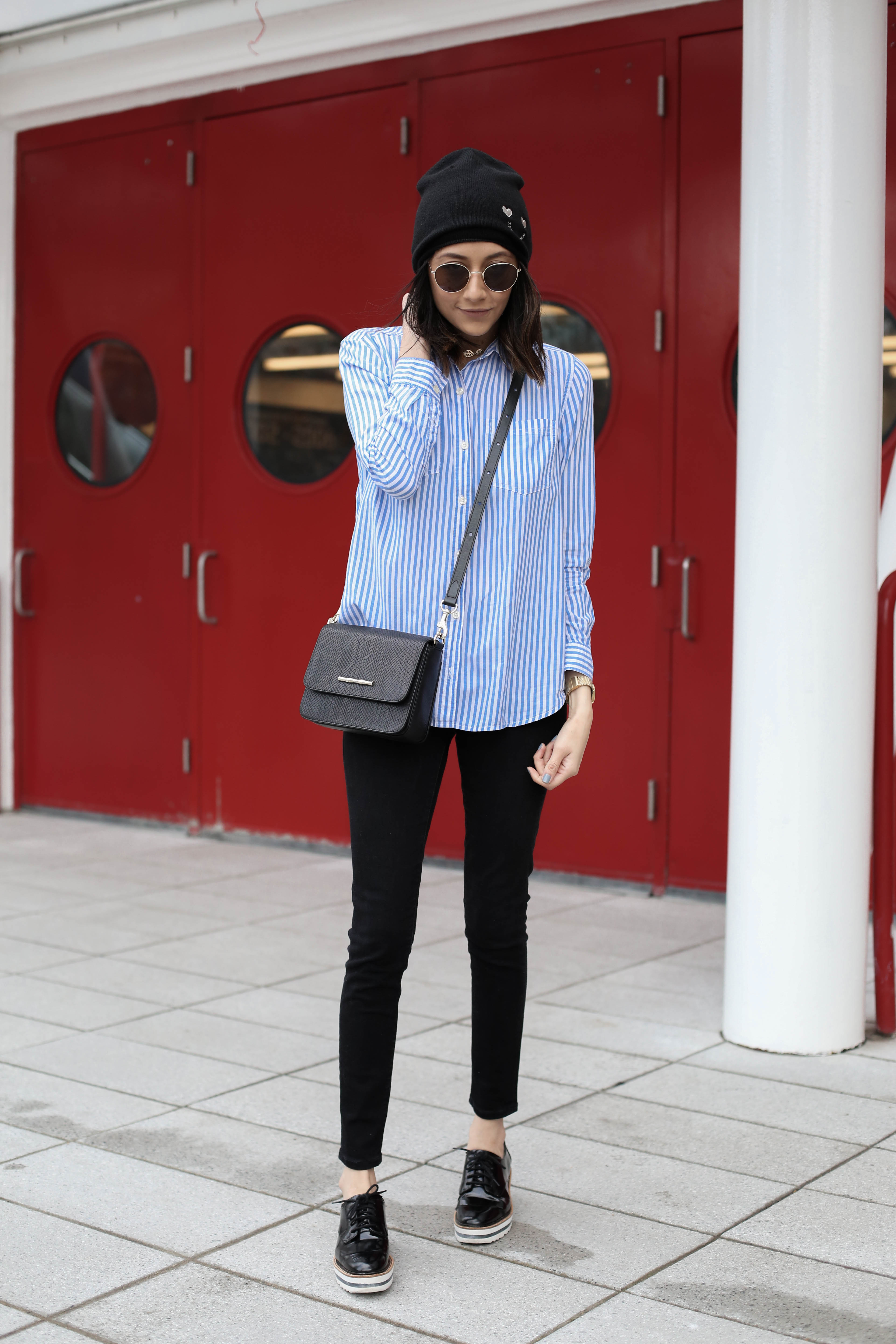 Style blogger Lilly Beltran wearing black skinny jeans and platform oxfords