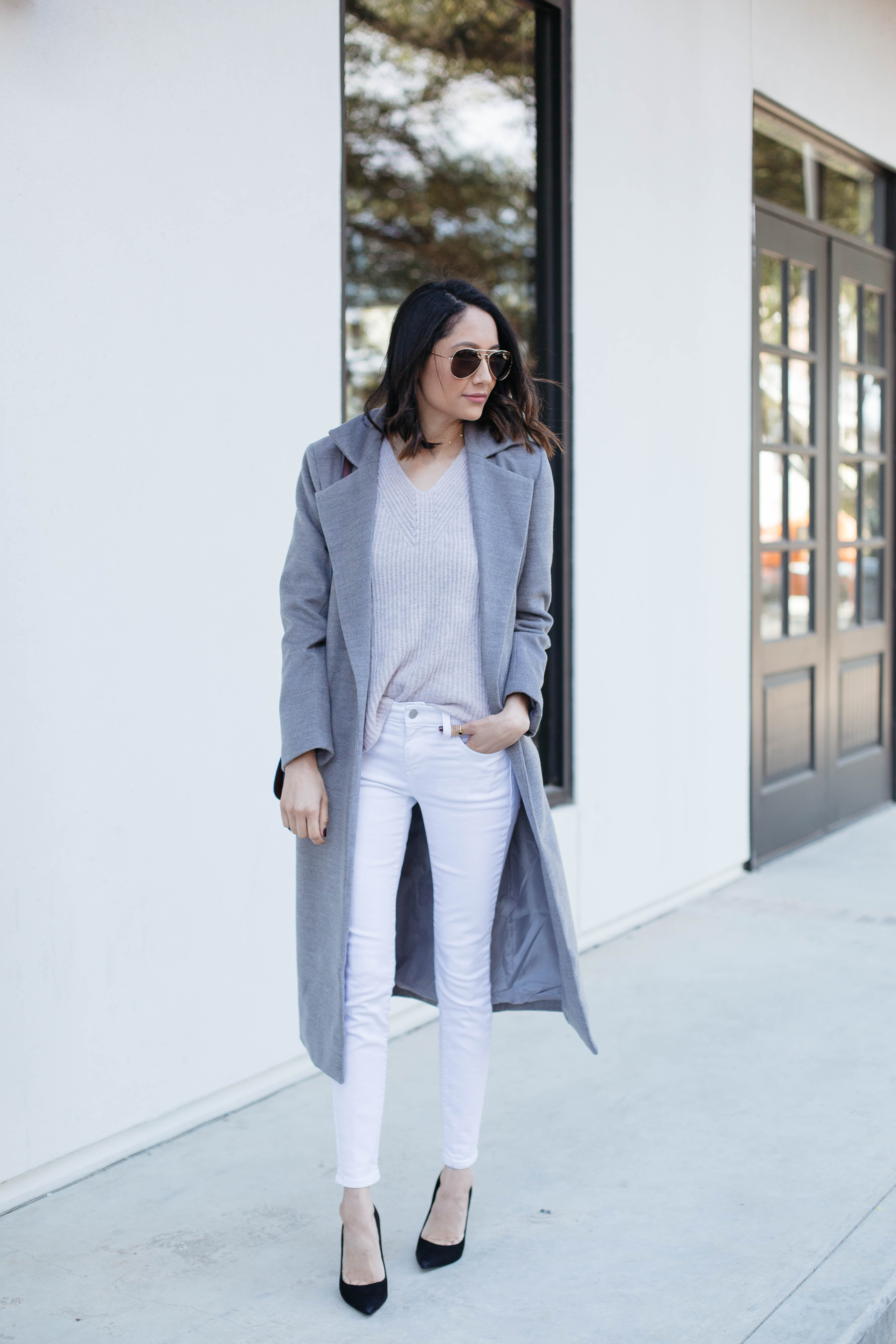 Lifestyle blogger Lilly Beltran of Daily Craving in a Fall look with a grey wool coat, Madewell pink sweater and white denim