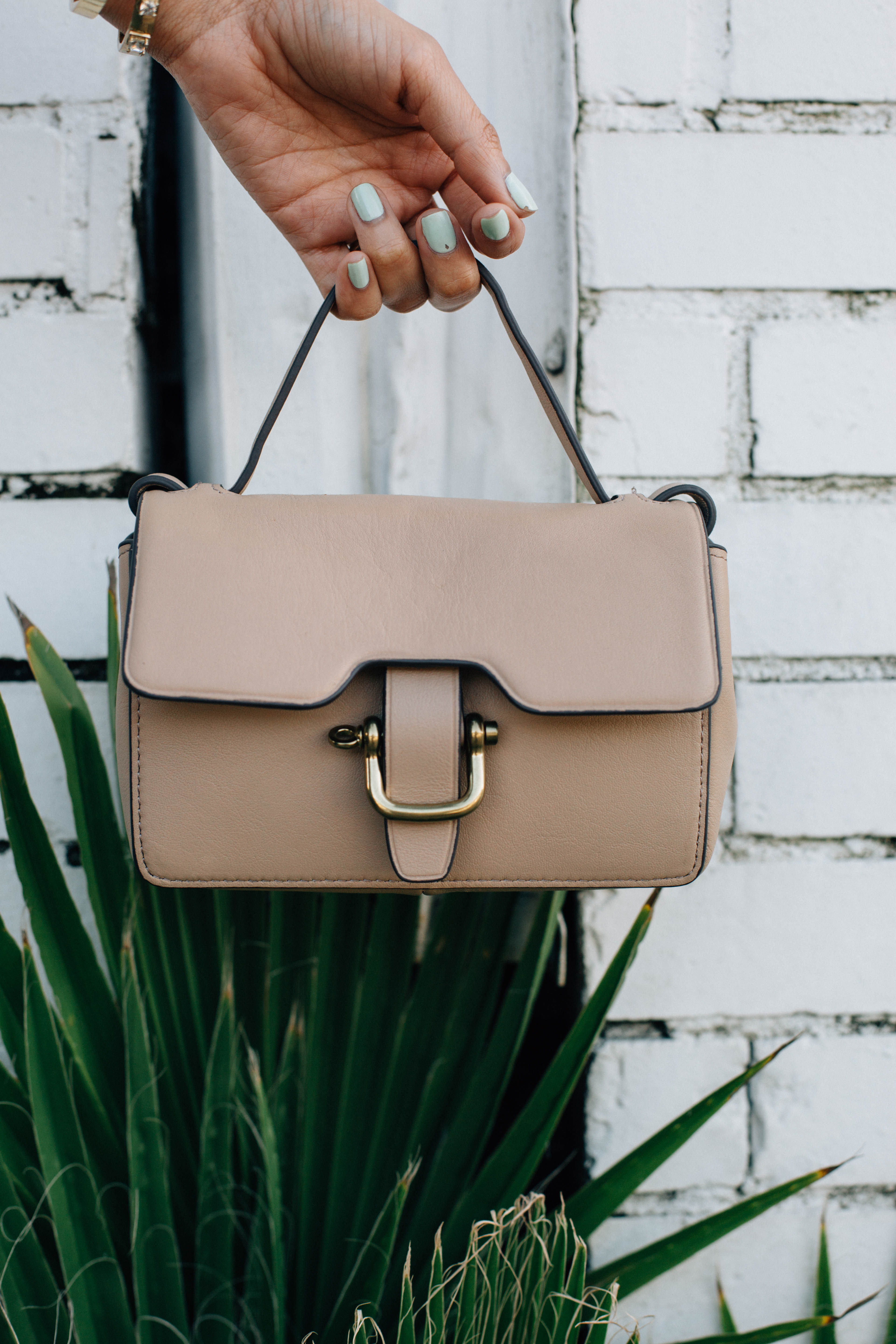 Lilly Beltran of Style Blog Daily Craving with a J.Crew mini leather bag