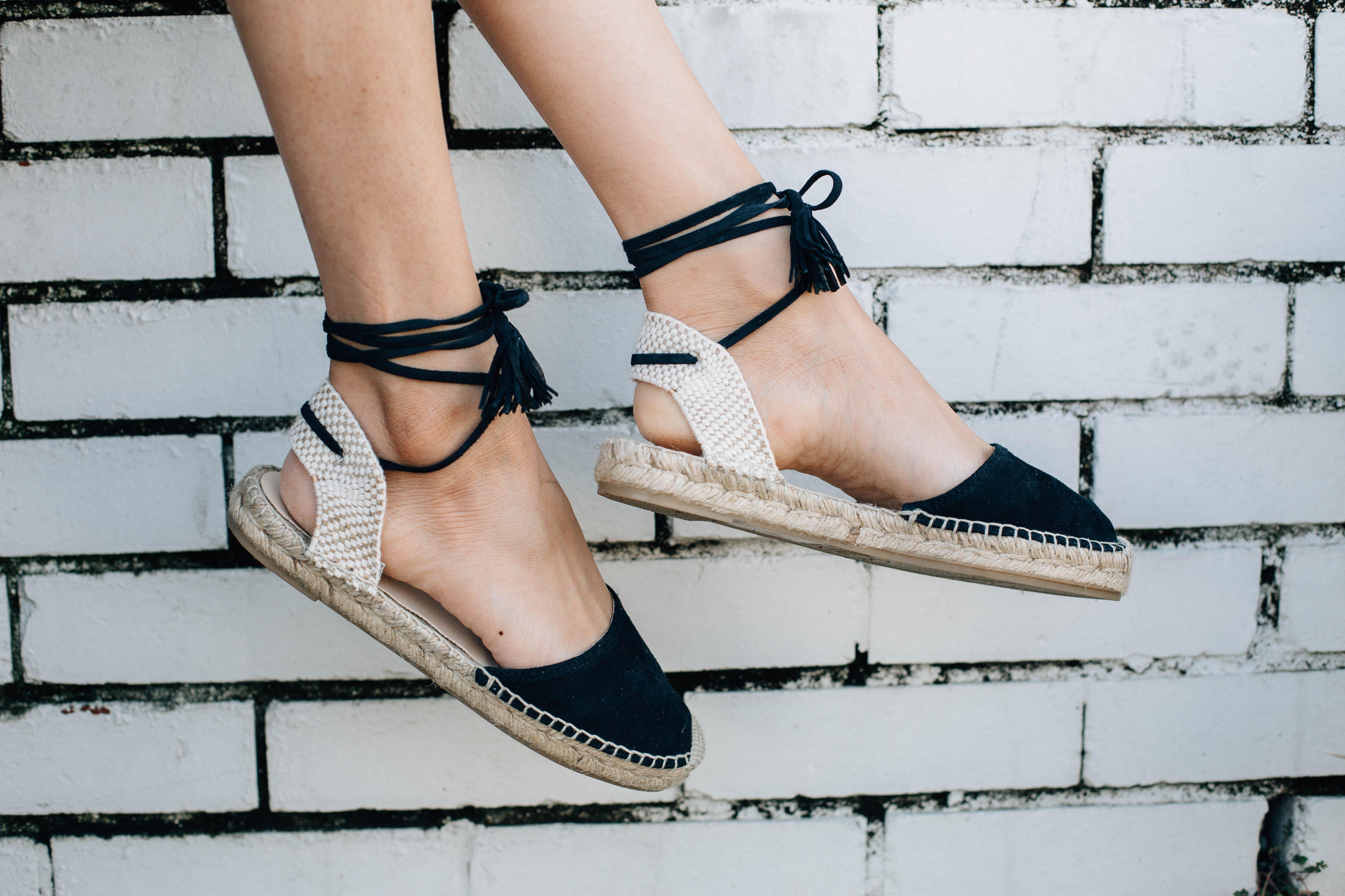 Lilly Beltran of Daily Craving blog wearing black lace-up espadrilles