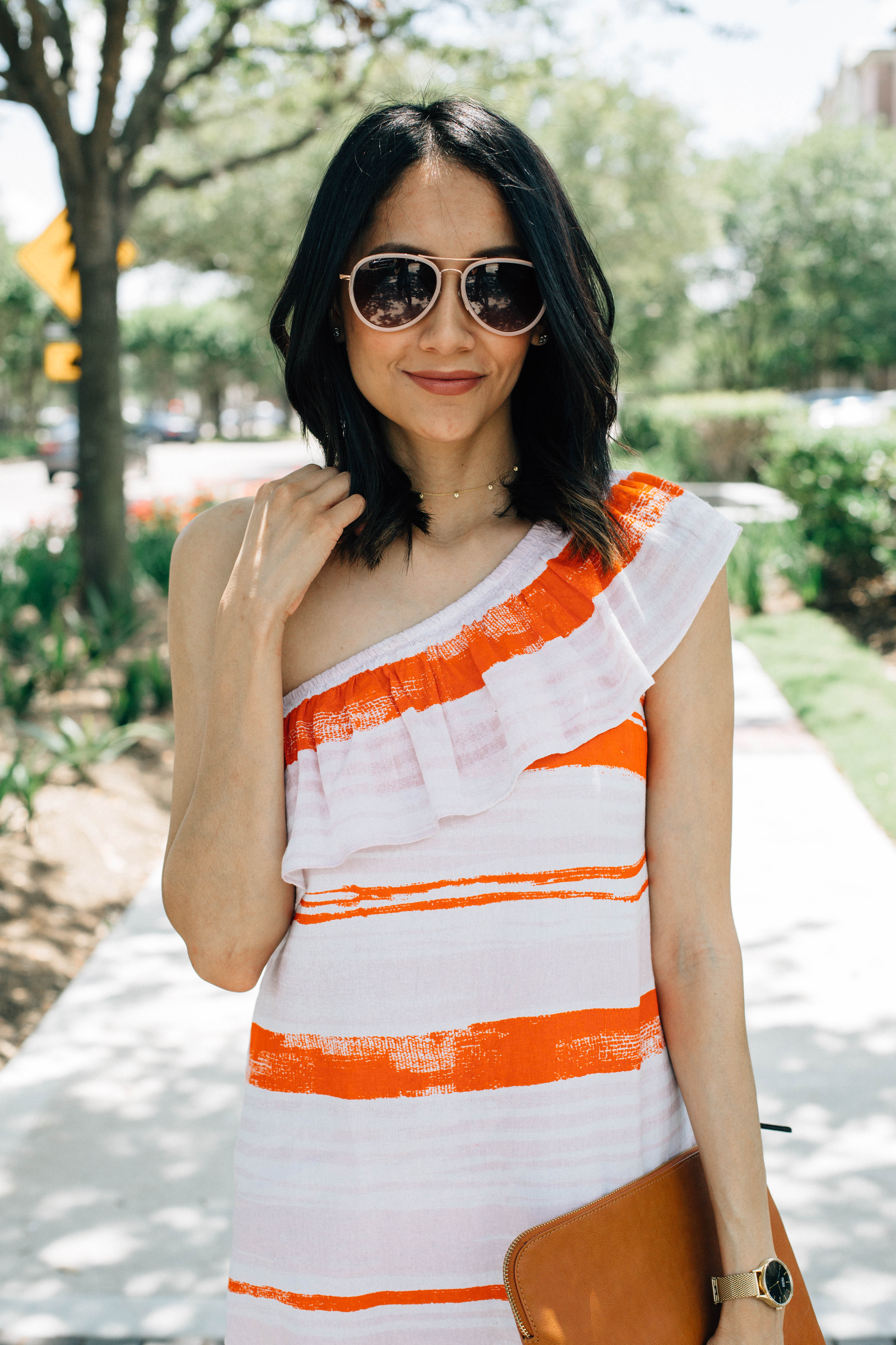 Style blogger Lilly Beltran of Daily Craving in a Lilla P one shoulder dress and pink Ann Taylor aviator sunglasses