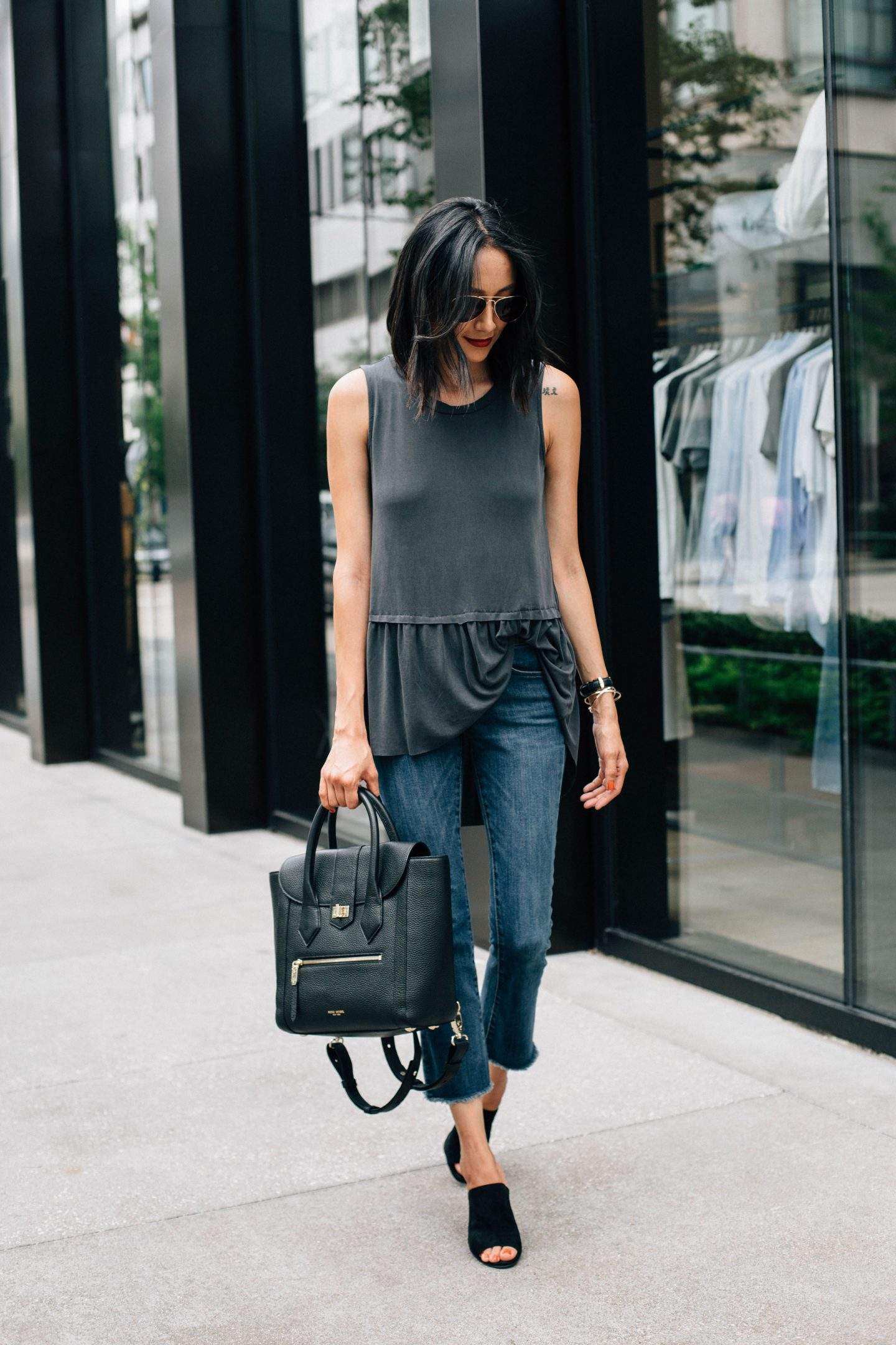 Lifestyle blogger Lilly Beltran wearing crop flare denim and black mules