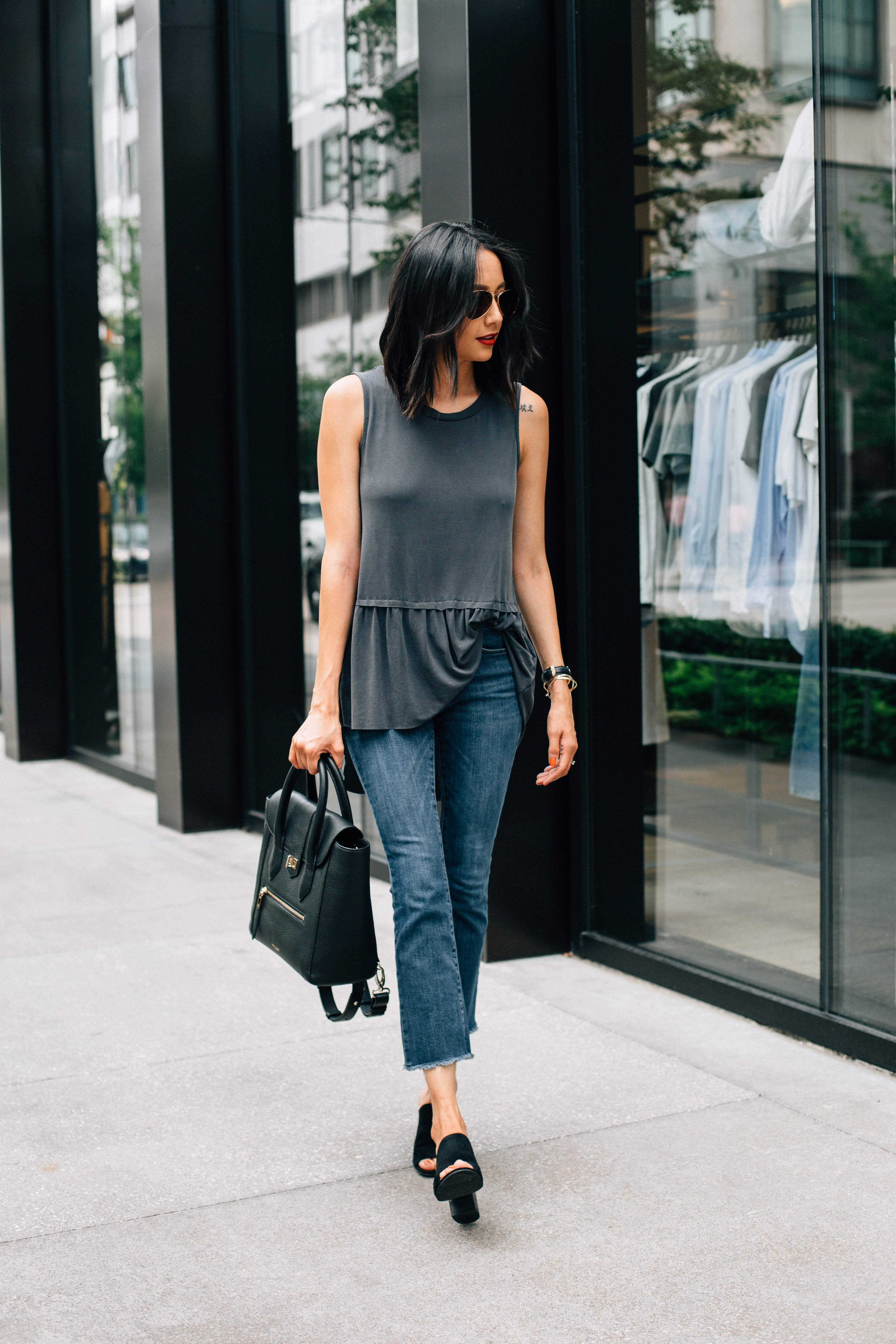 Lifestyle Blogger Lilly Beltran of Daily Craving in a casual look with crop flare denim and a peplum top