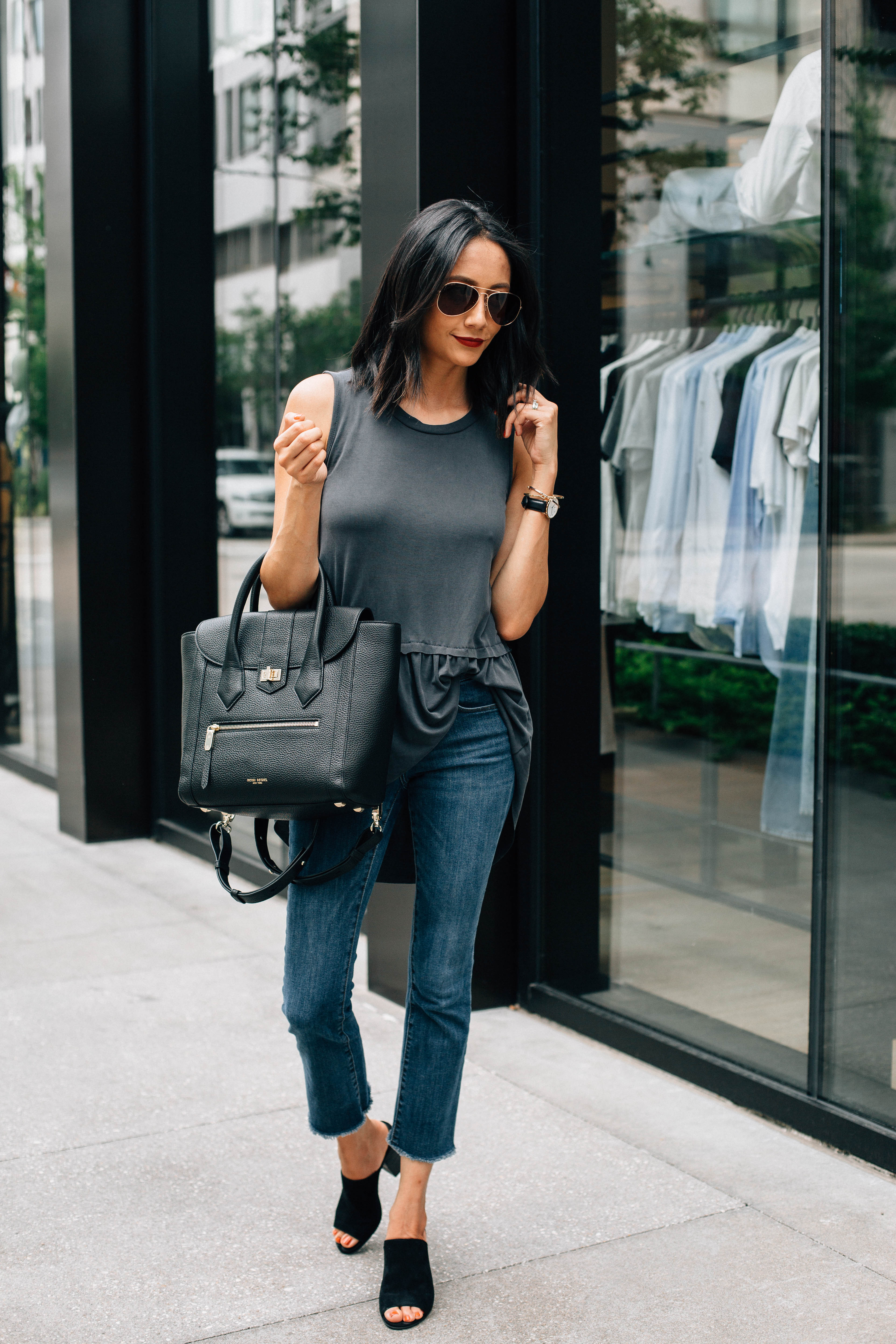 Lifestyle blogger Lilly Beltran of Daily Craving wearing a casual look with crop flare jeans and black mules