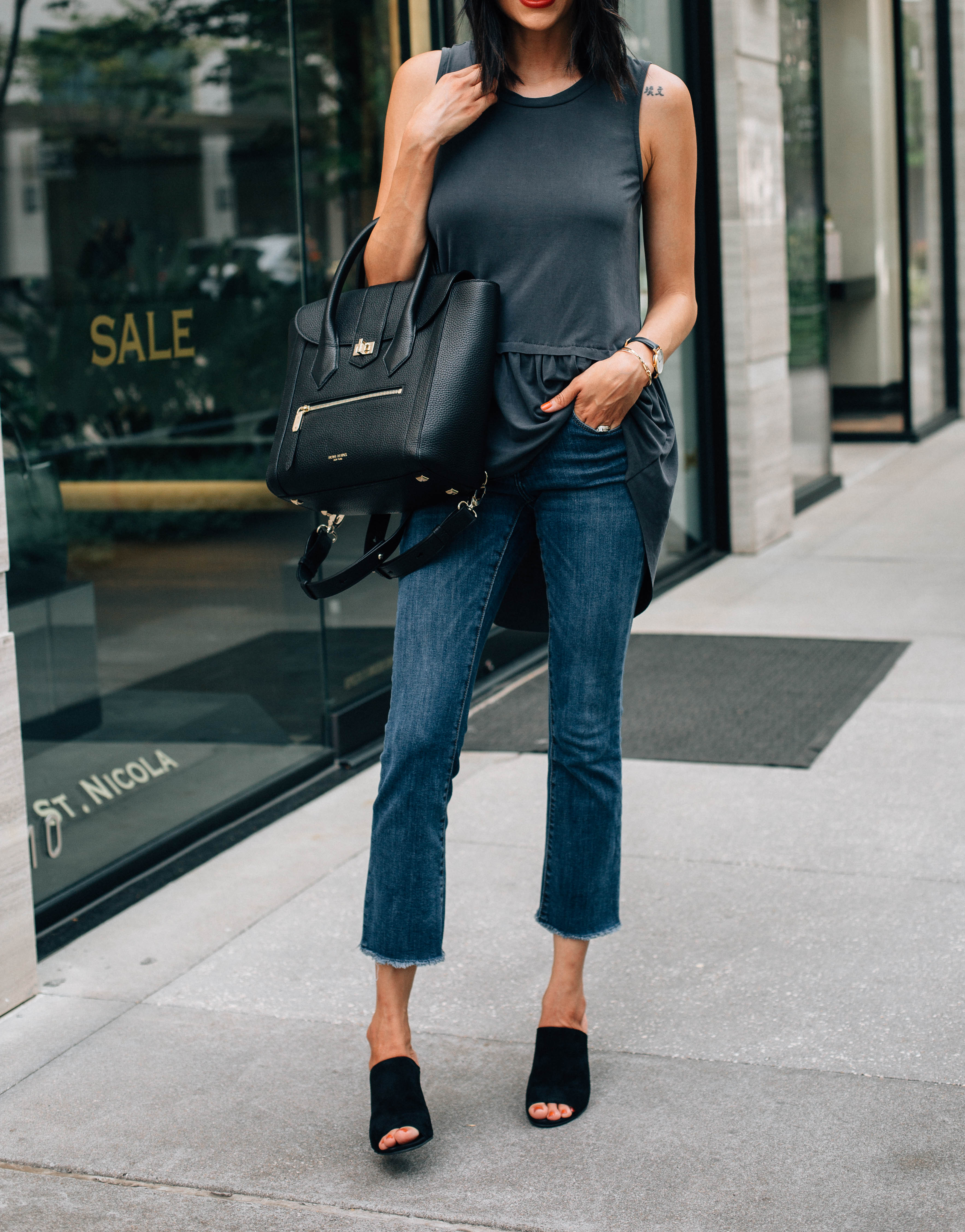 Lilly Beltran of Daily racing blog wearing crop jeans with a peplum top and suede mules