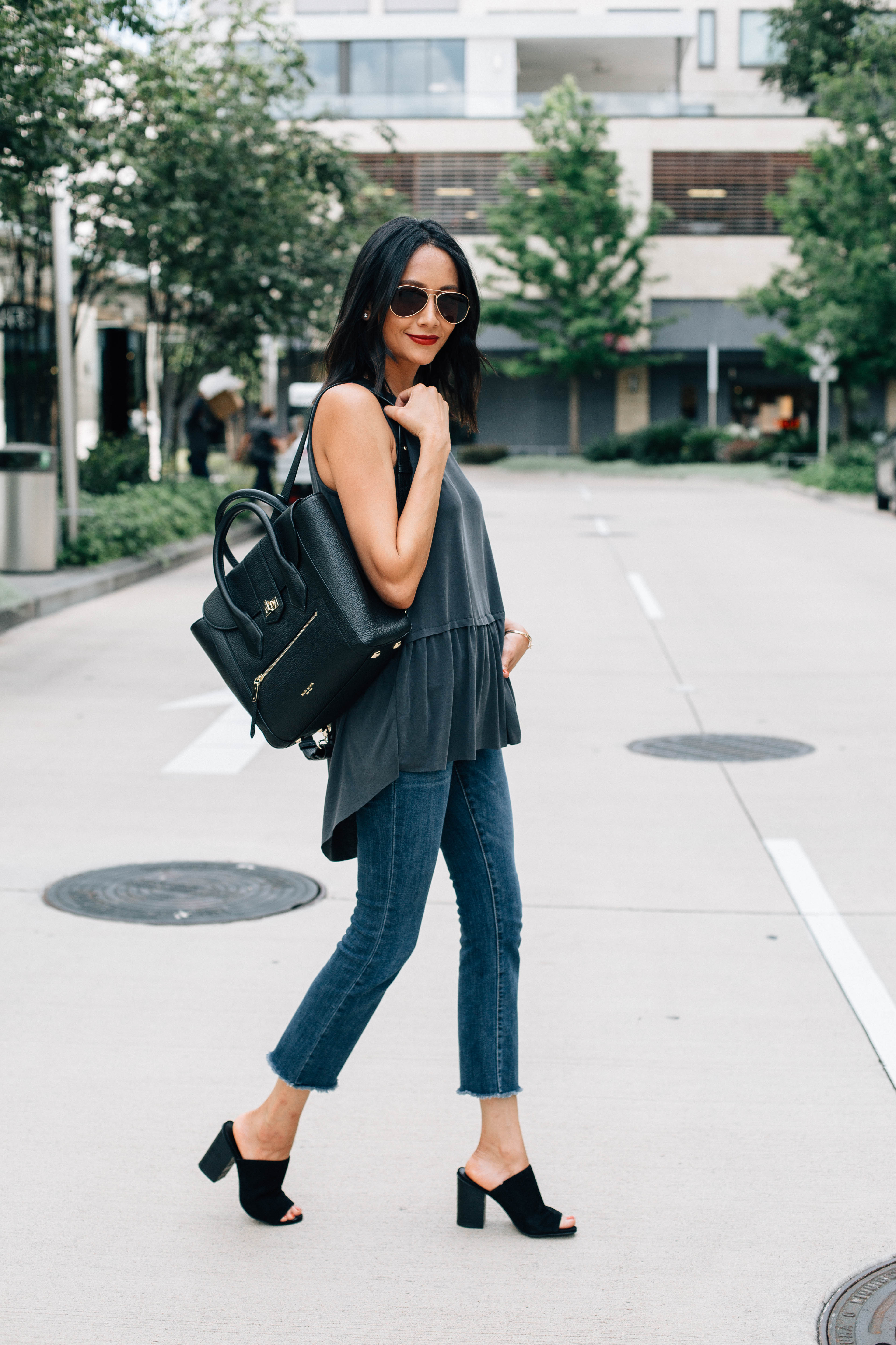 Lifestyle blogger Lilly Beltran of Daily Craving blog wearing block heel mules and a Henri Bendel backpack