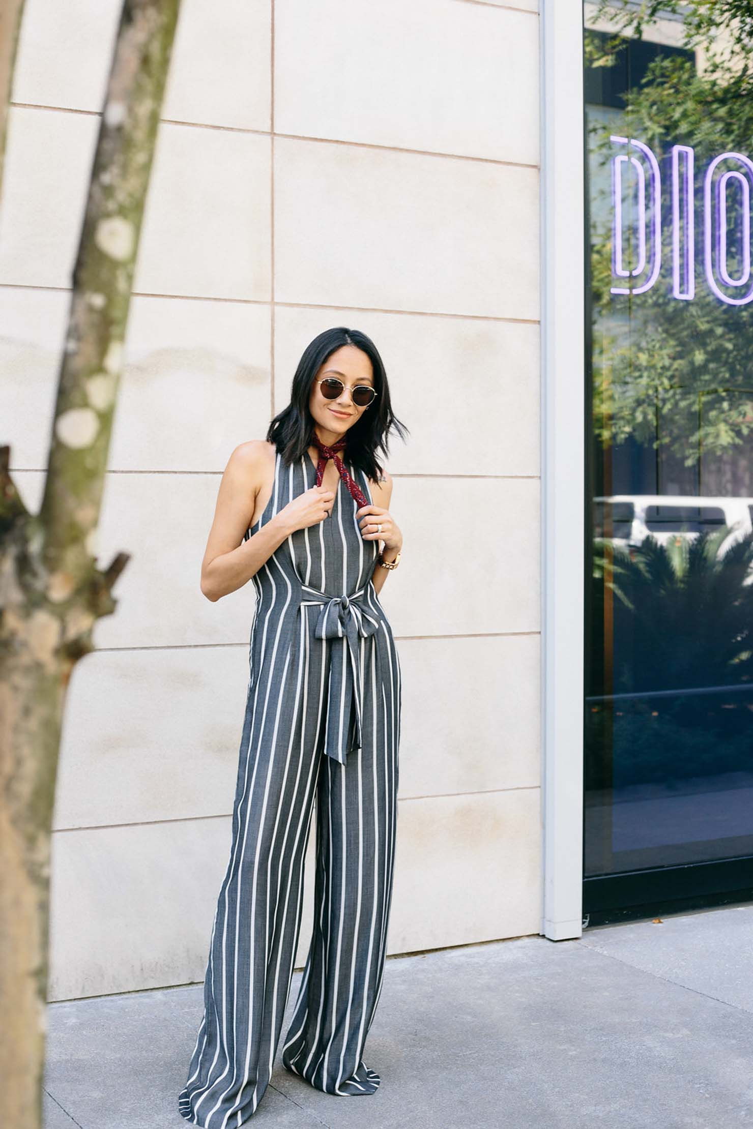 Style Blogger Lilly Beltran wearing a wide leg striped jumpsuit