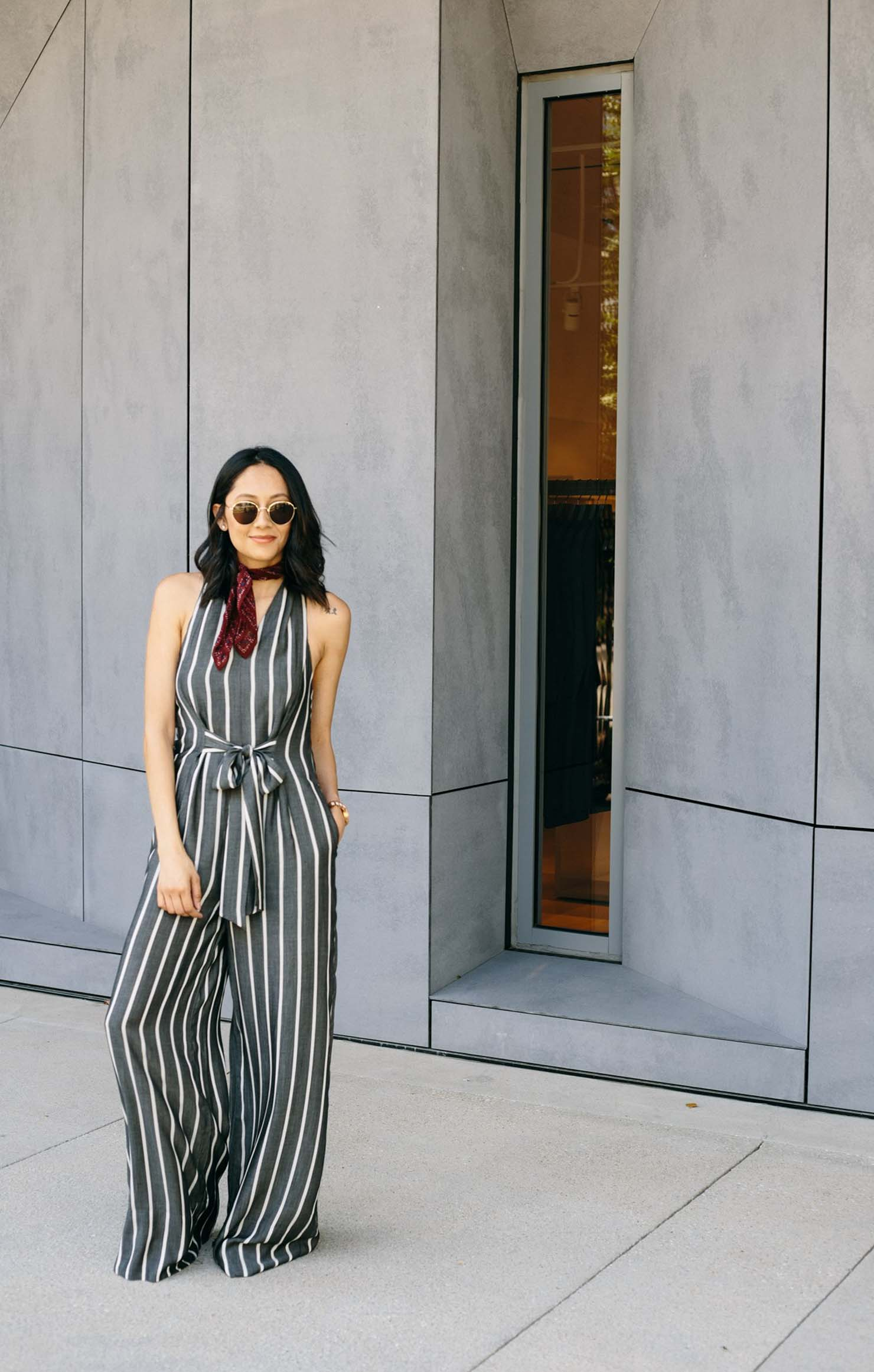 Lilly Beltran of Daily Craving in a grey and white striped jumpsuit