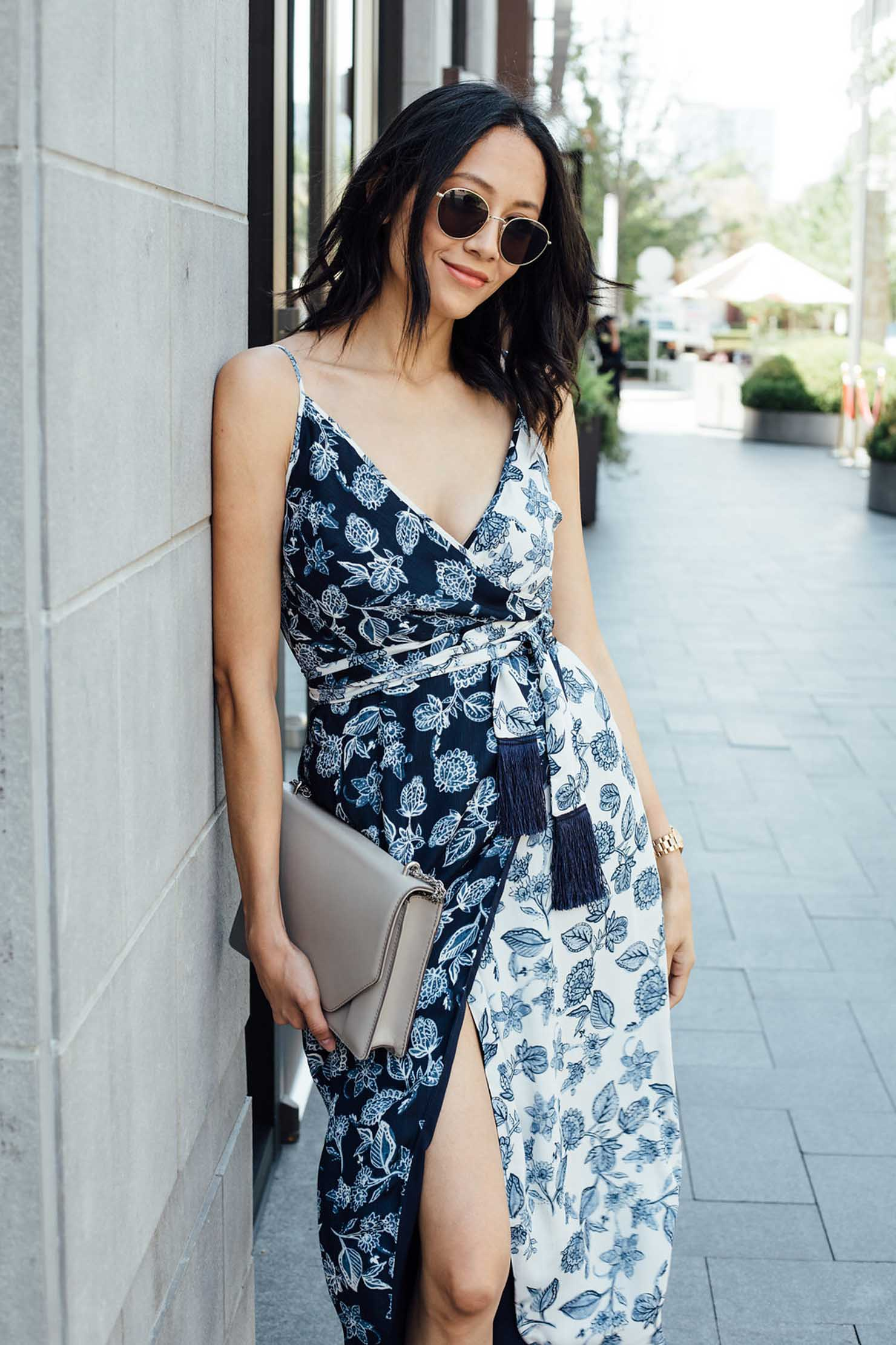 Style blogger Lilly Beltran of Daily Craving blog wearing a chic fall look in a floral print wrap dress
