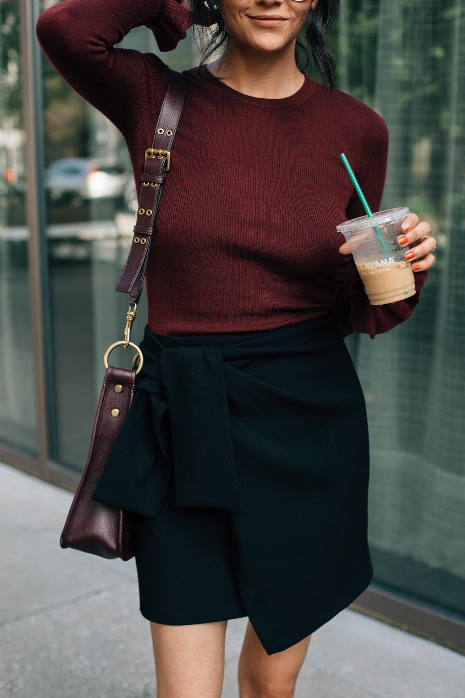 Style blogger Lilly Beltran wearing a casual fall look with a Burgundy sweater and black wrap skirt