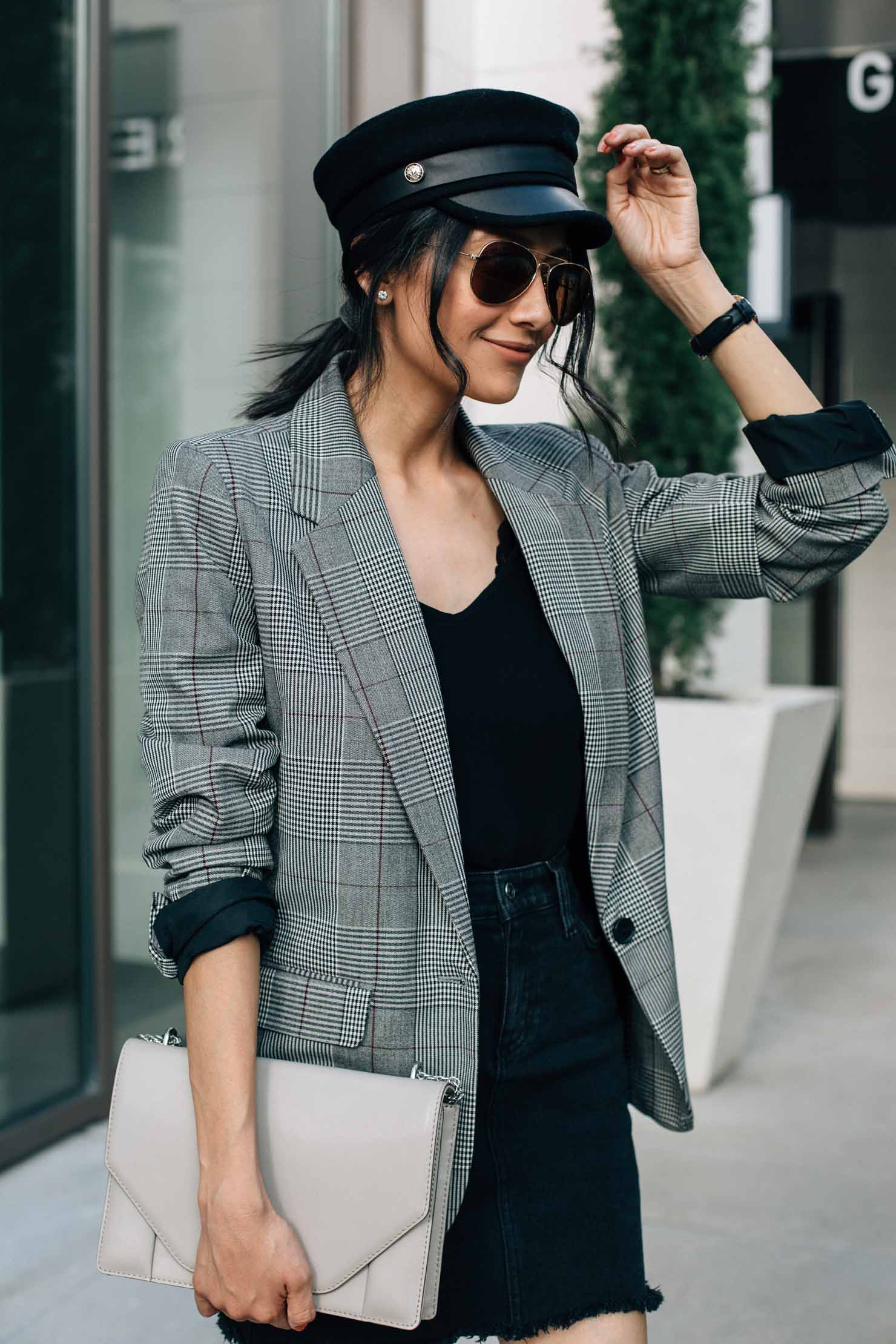 Lilly Beltran of Style blog Daily Craving wearing a baker boy hat and plaid blazer