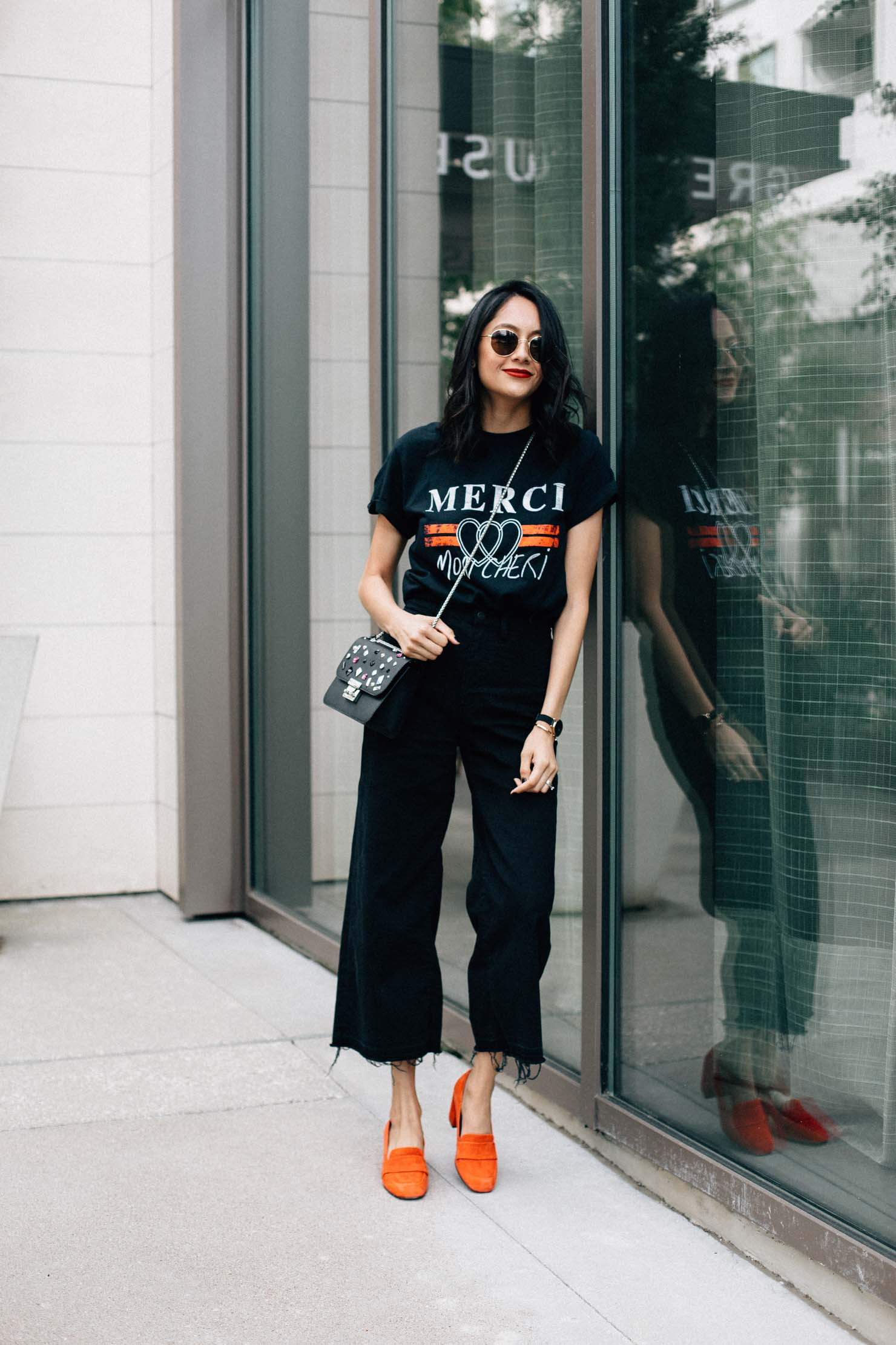Lilly Bletran of Daily Craving shares her love for casual dressing by pairing red pumps with black wide leg denim