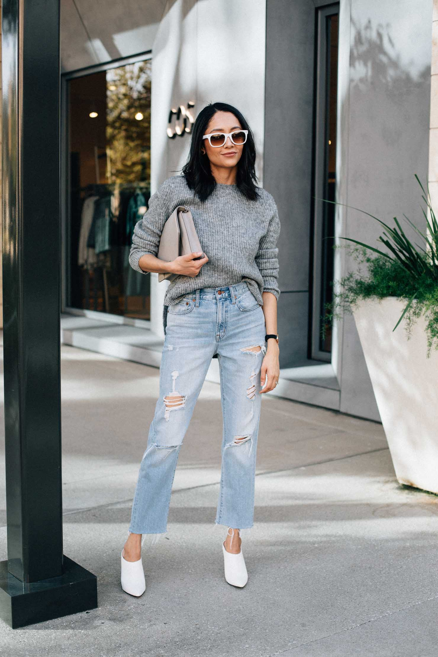 Style blogger Daily Craving wearing an oversized sweater with vintage denim and white shoes for a casual fall outfit