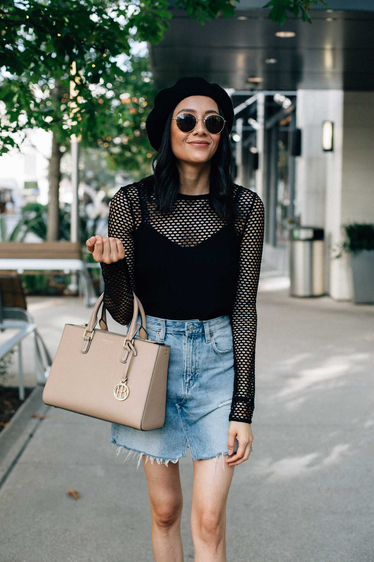 Fashion blogger Lilly Beltran from Daily Craving wearing a long sleeve mesh top and a black beret