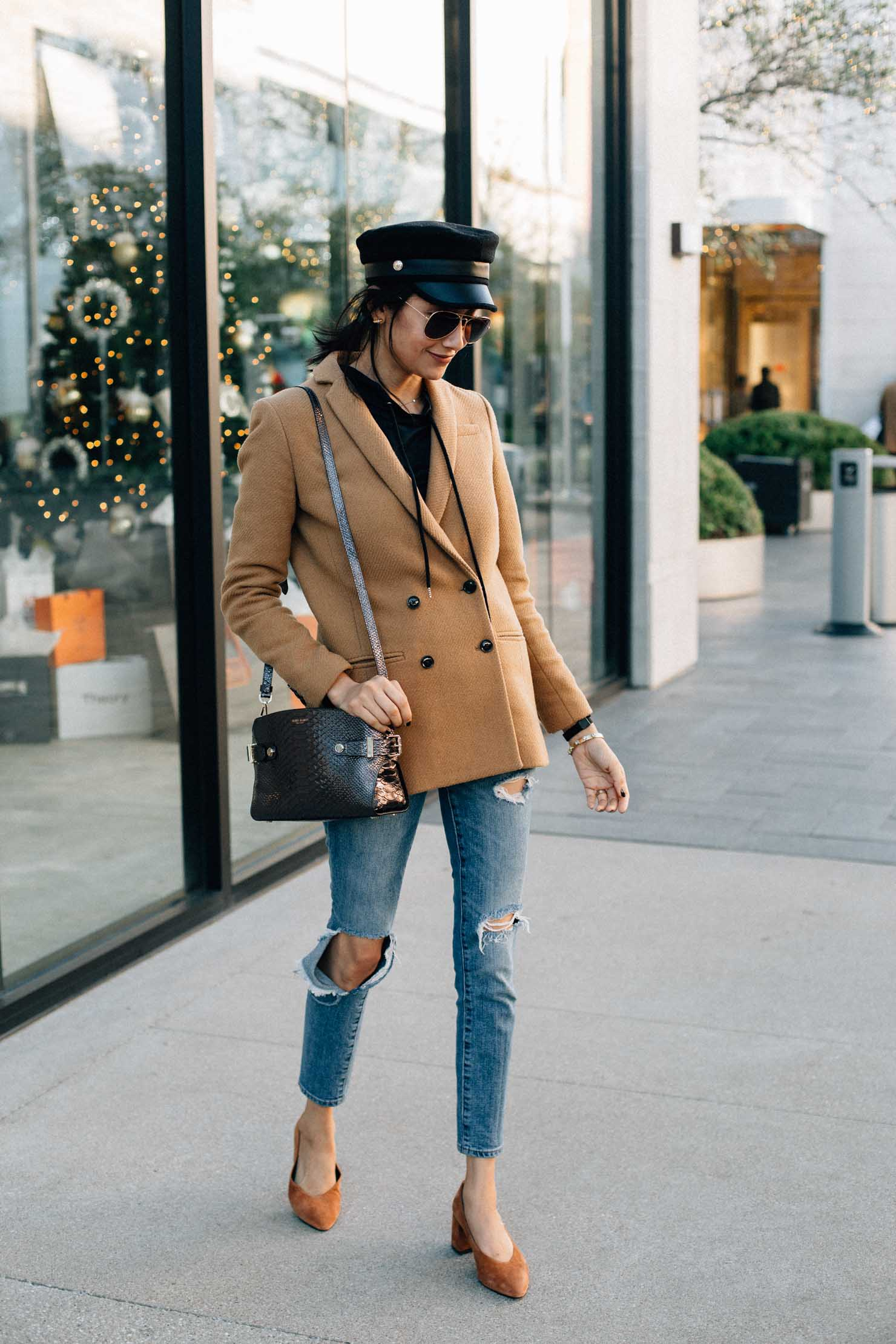 style blogger Lilly Beltran wearing a camel wool coat, ripped skinny jeans & suede pumps for a chic fall look