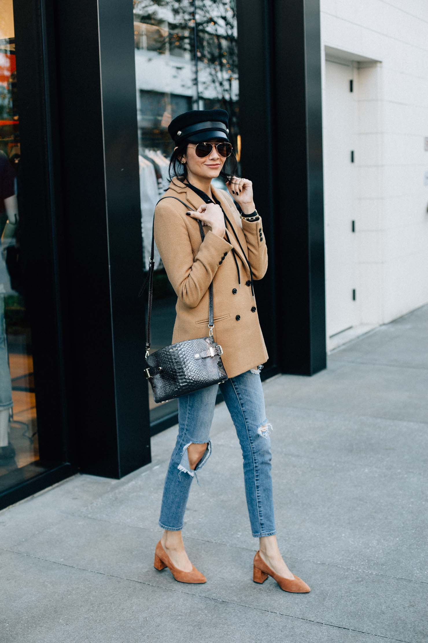 Lilly Beltran of Daily Craving wearing chic fall & winter outfits with a wool coat, suede pumps and bake boy cap