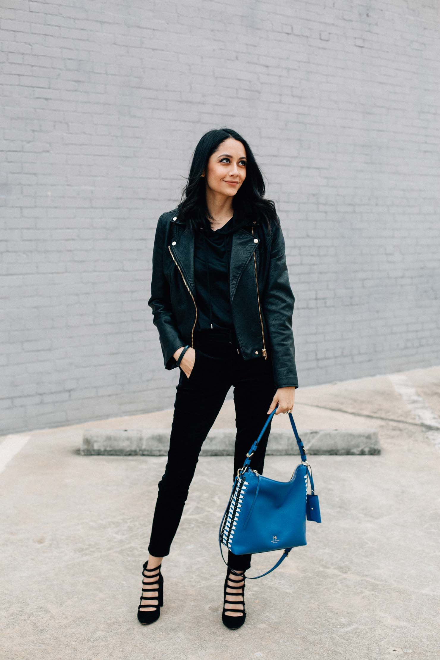 Lilly Beltran of Daily Craving in a chic look wearing velvet trousers, silk hoodie & a Blank NYC Moto jacket