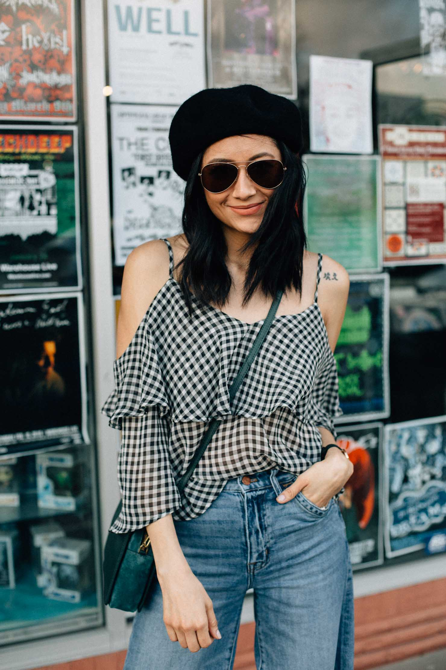 Lilly Beltran of Daily Craving blog styles a Ten Sixty Sherman gingham top with wide leg denim and a wool beret for an effortless street style look