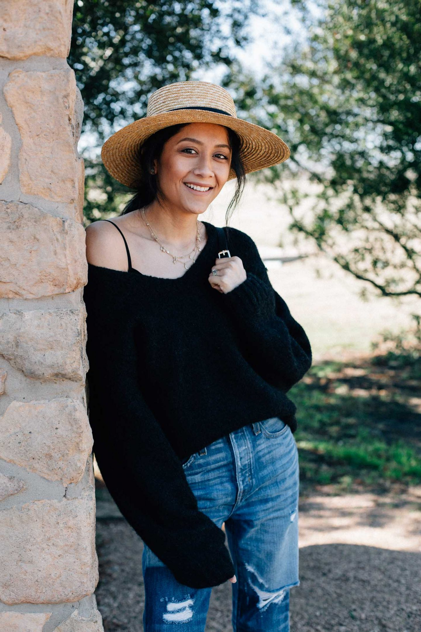 Lilly Beltran of Daily Craving wearing an effortless look with straight fit jeans and an oversized black sweater
