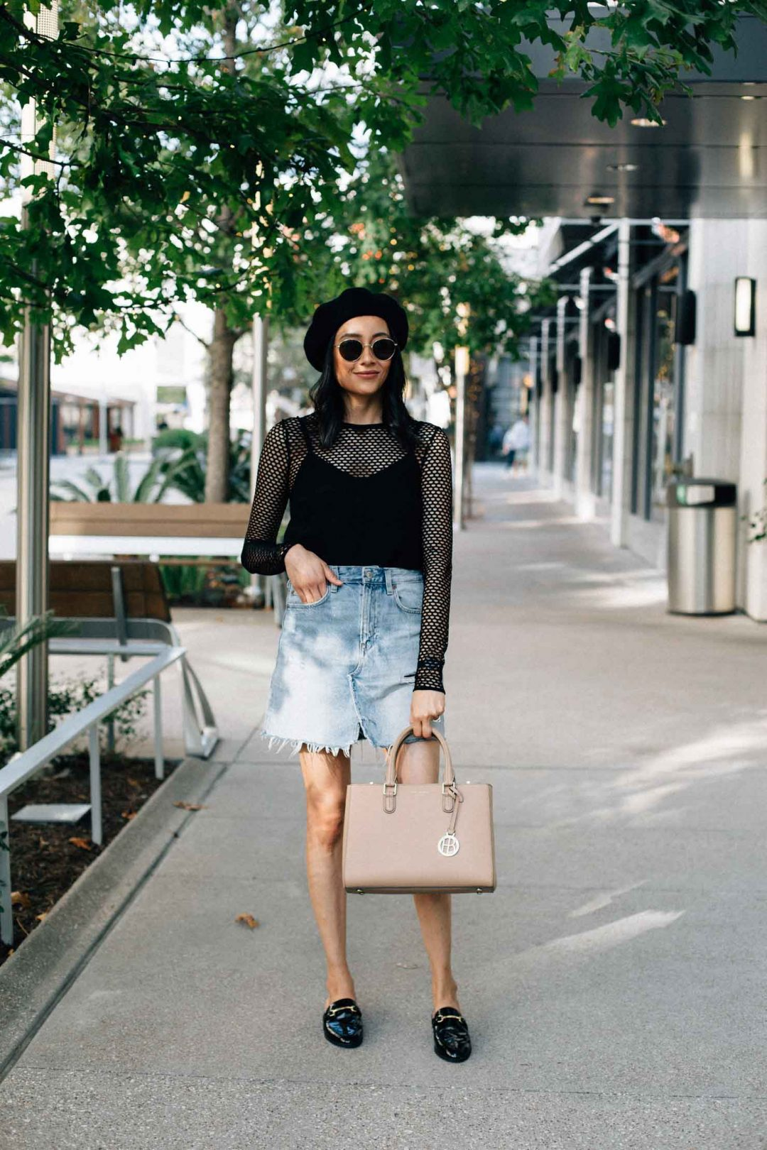 Lilly Beltran of Daily Craving styles a denim skirt with a mesh top and black beret for a Parisian inspired look