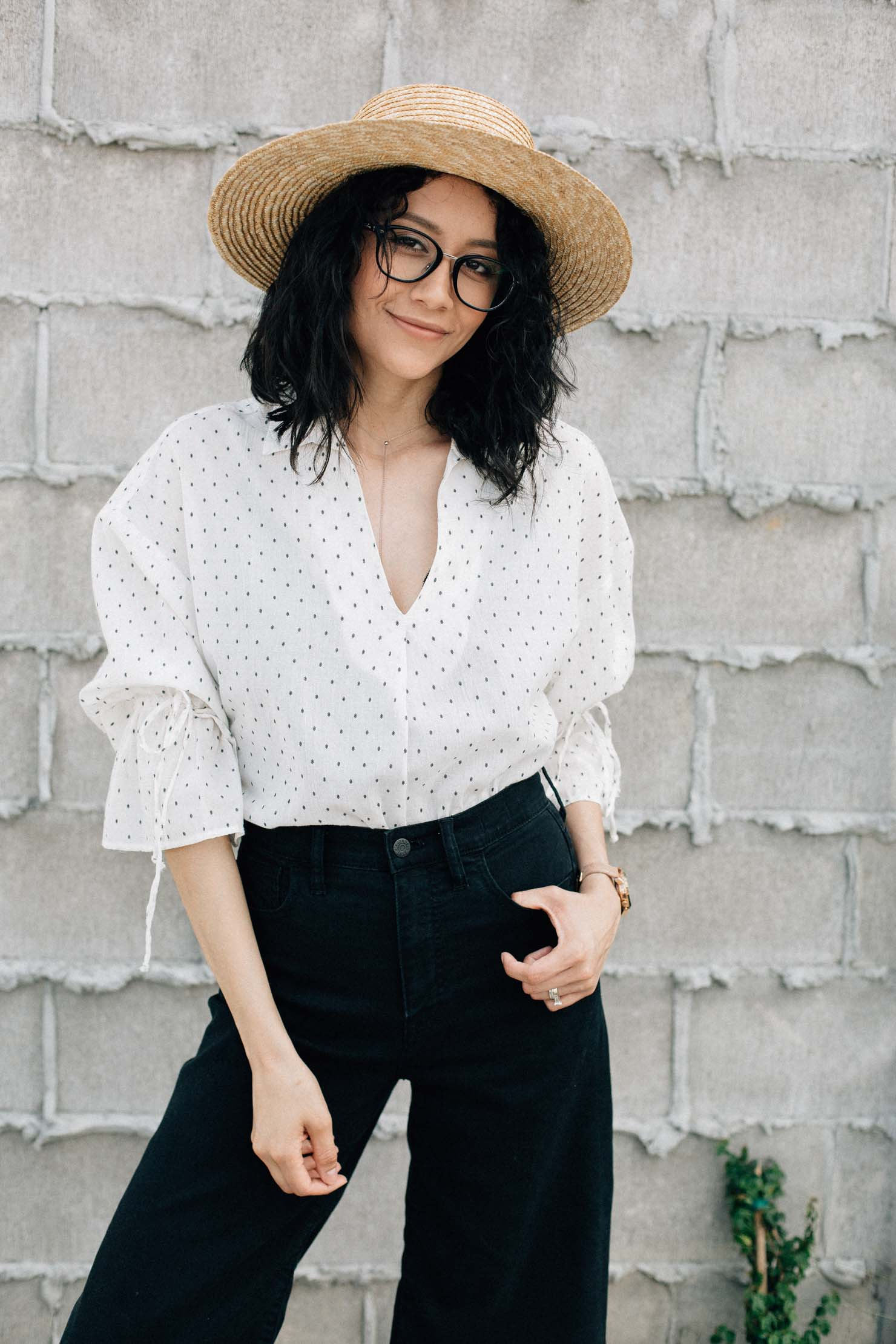 Spring outfit | Straw hat, black wide leg denim and H&M bell sleeve top