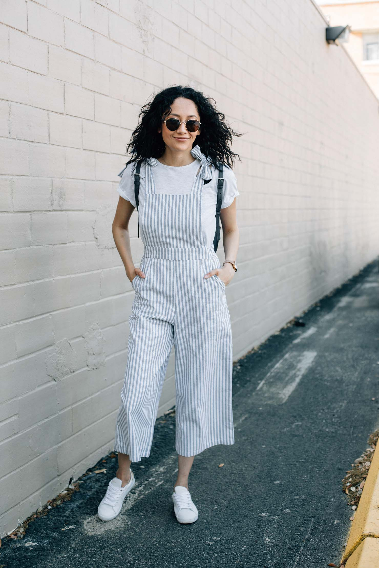 Spring jumpsuits for spring under $50 | Striped jumpsuit, white sneakers & white tee